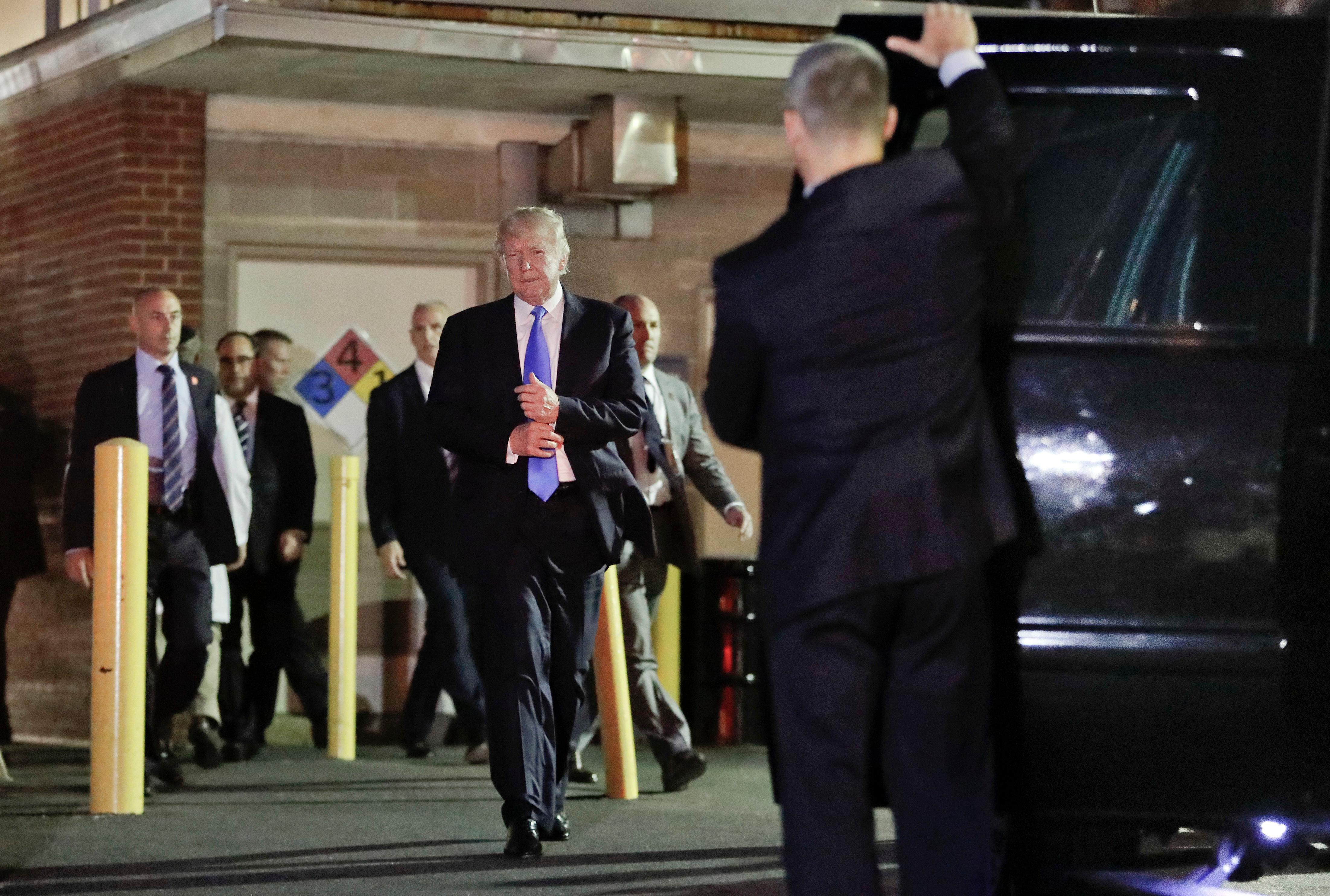 President Donald Trump walks to his motorcade vehicle after visiting MedStar Washington Hospital Center in Washington, Wednesday, June 14, 2017, where House Majority Leader Steve Scalise of La. was taken after being shot in Alexandria, Va., during a Congressional baseball practice. (AP Photo/Pablo Martinez Monsivais)