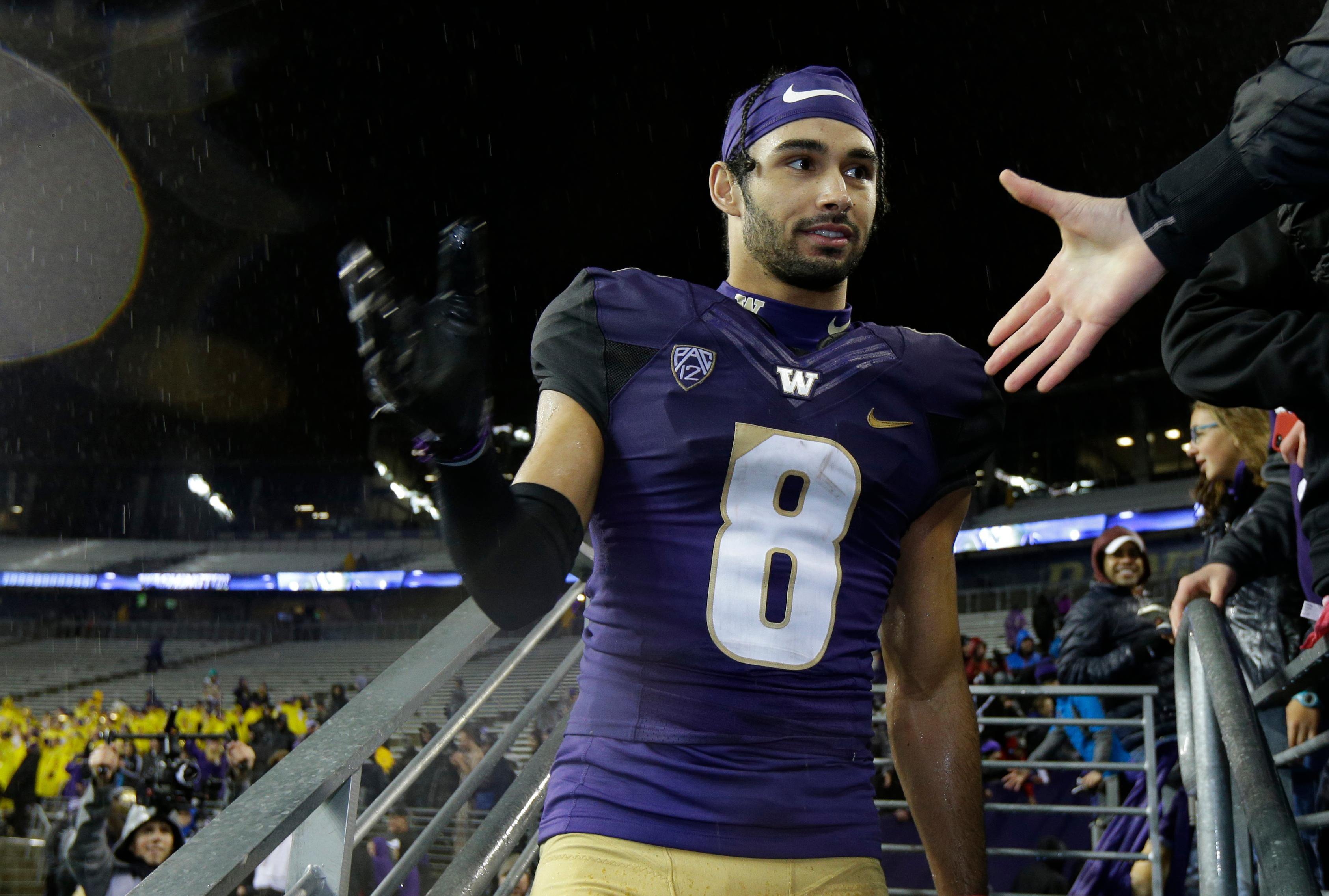 Washington wide receiver Dante Pettis greets fans after an NCAA college football game against Oregon, Saturday, Nov. 4, 2017, in Seattle. Pettis set a new NCAA record for punt-return touchdowns when he scored in the second quarter and Washington won 38-3. (AP Photo/Ted S. Warren)