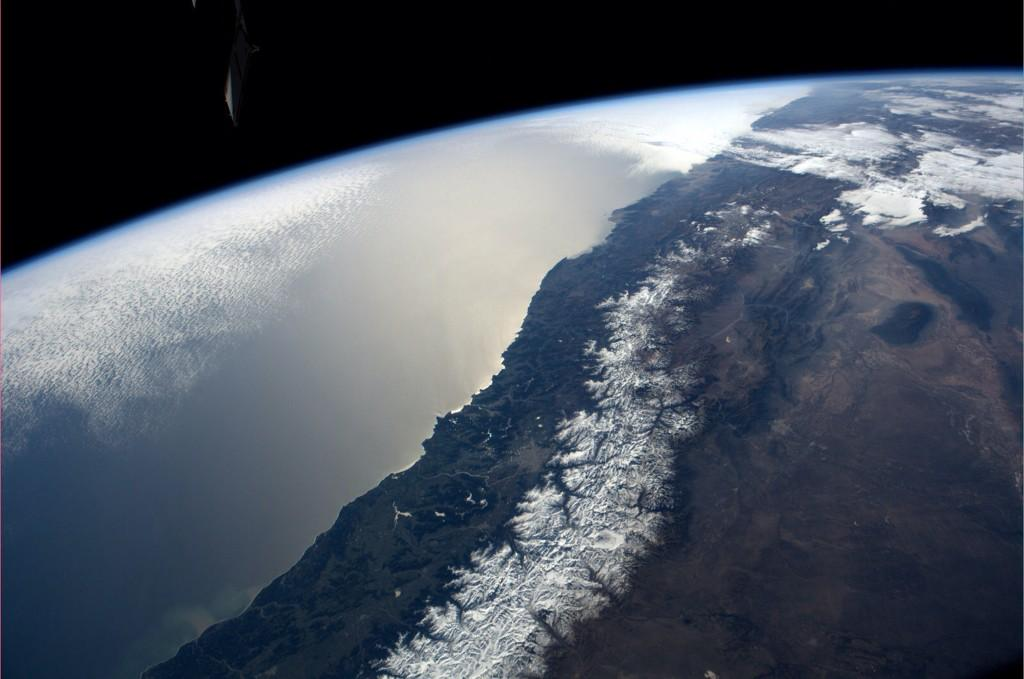 A nice after dinner view of the snowcapped Andes looking northwest. (Photo & Caption: Reid Wiseman, NASA)