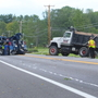 Dump truck rolls over, briefly closes road in Cicero