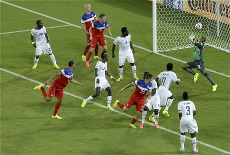 United States' John Brooks, second from left, scores his side's second goal during the group G World Cup soccer match between Ghana and the United States at the Arena das Dunas in Natal, Brazil, Monday, June 16, 2014.