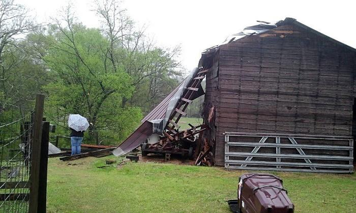 A barn in Fayette County sustained storm damage on Thursday, April 11, 2013.