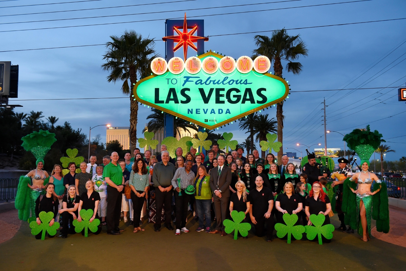 "Local officials, business people, showgirls, pipers and Irish dancers pose in front of the ""Welcome to Fabulous Las Vegas"" sign as it is turned green in honor of St. Patrick's Day Thursday, March 16, 2017. (Sam Morris/Las Vegas News Bureau)"