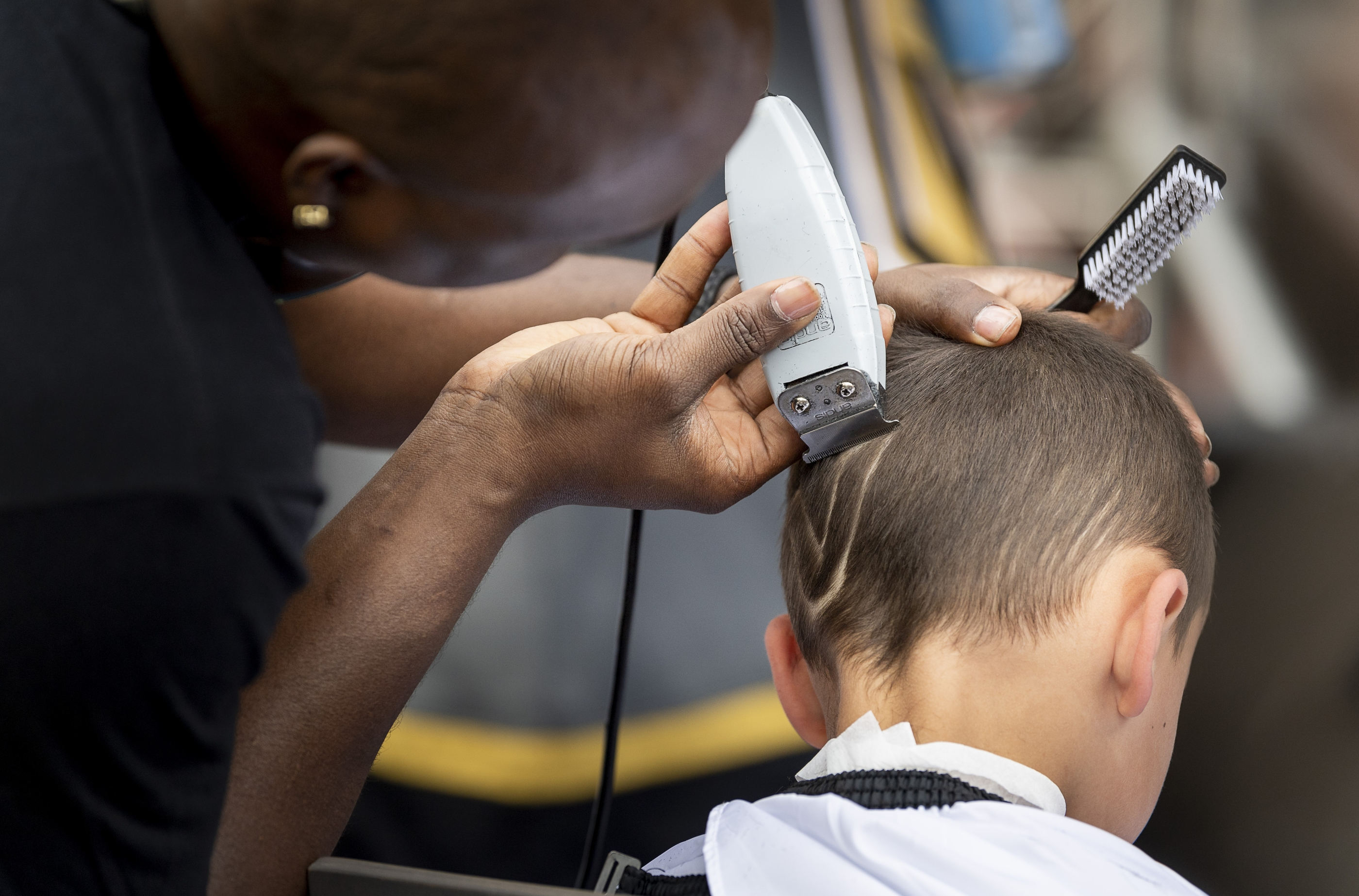 A youngster gets an appropriate hairstyle in the pre-game celebration in Toshiba Plaza as the Vegas Golden Knights prepare to meet the Los Angeles Kings in the first quarterfinal game of the NHL Stanley Cup Playoffs at T-Mobile Arena in Las Vegas on Wednesday, April 11, 2018.  CREDIT: Mark Damon/Las Vegas News Bureau