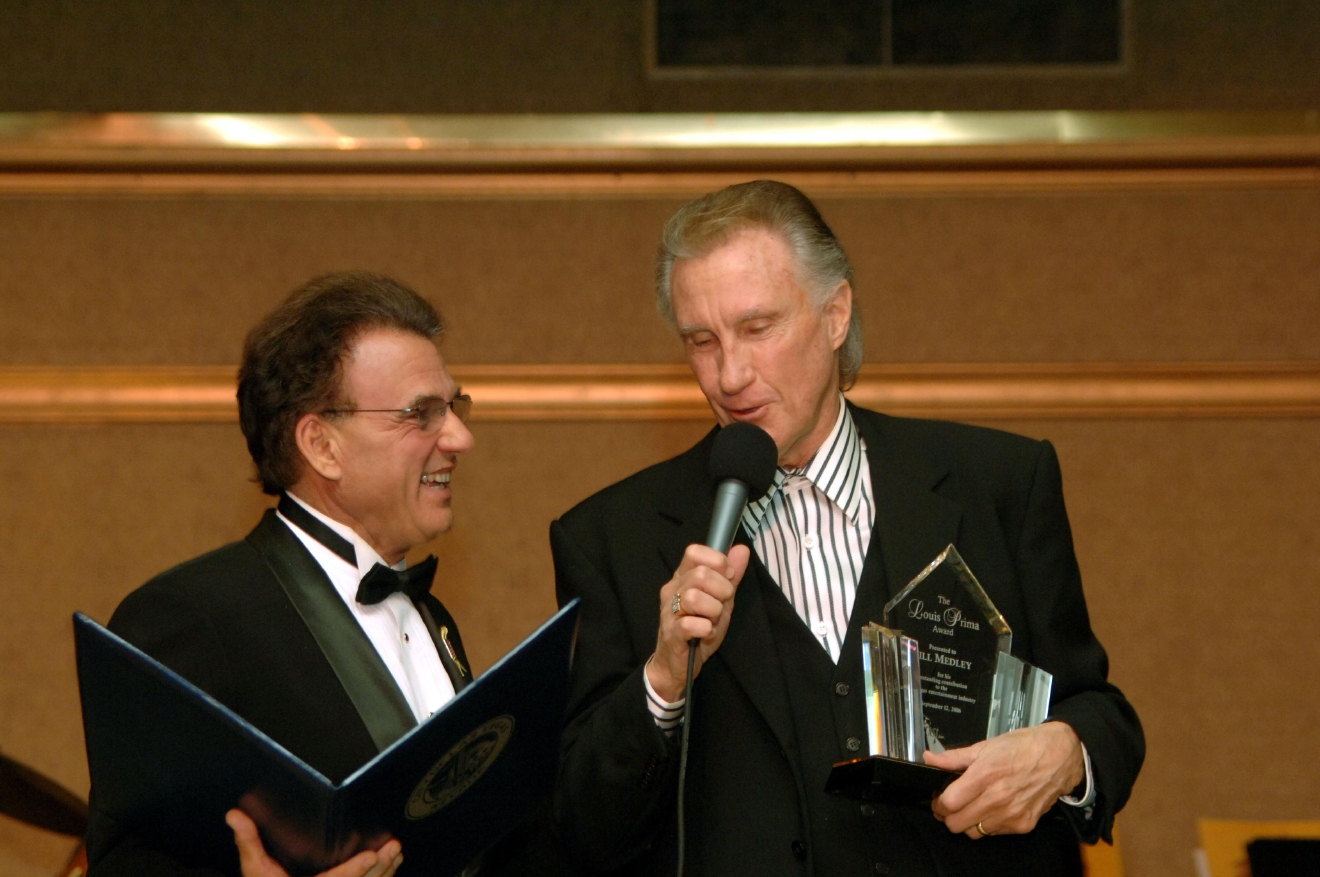 Tony Sacca (left) presents Bill Medley with the Inagural Louis Prima Award at the Sahara Hotel in Las Vegas on Sept. 11, 2006. [Bob Brye/Las Vegas News Bureau]