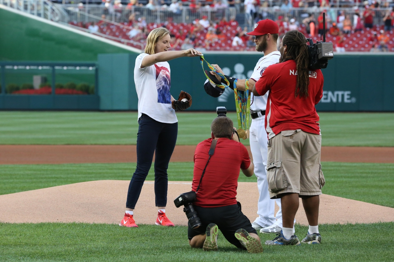 Olympic wunderkind and Maryland native Katie Ledecky sported a Washington Nationals hat when she threw out the opening pitch at the Battle of the Beltway on Aug. 24. Although Ledecky won her medals for swimming, there's apparently nothing she can't do - Ledecky didn't have any problem tossing the ball to home base. (Amanda Andrade-Rhoades/DC Refined)