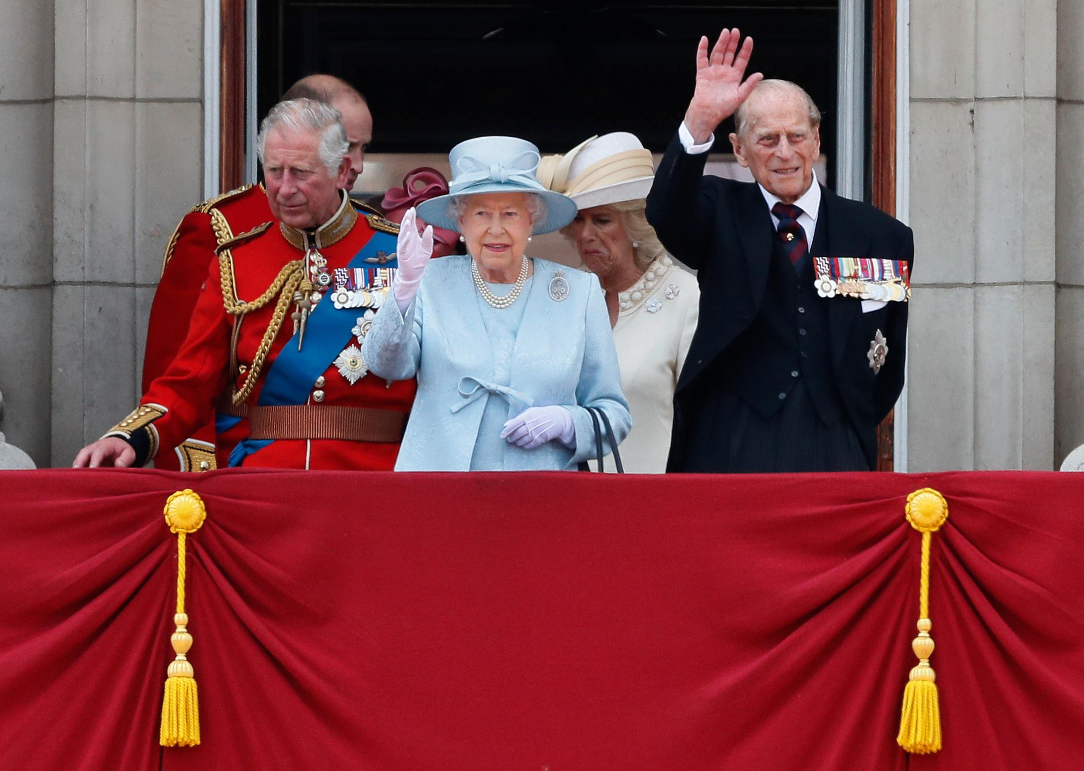 From left, Britain's Prince Charles, Queen Elizabeth II, Prince Philip, the Duke of Edinburgh appear on the balcony of Buckingham Palace, after attending the annual Trooping the Colour Ceremony in London, Saturday, June 17, 2017. (AP Photo/Kirsty Wigglesworth)