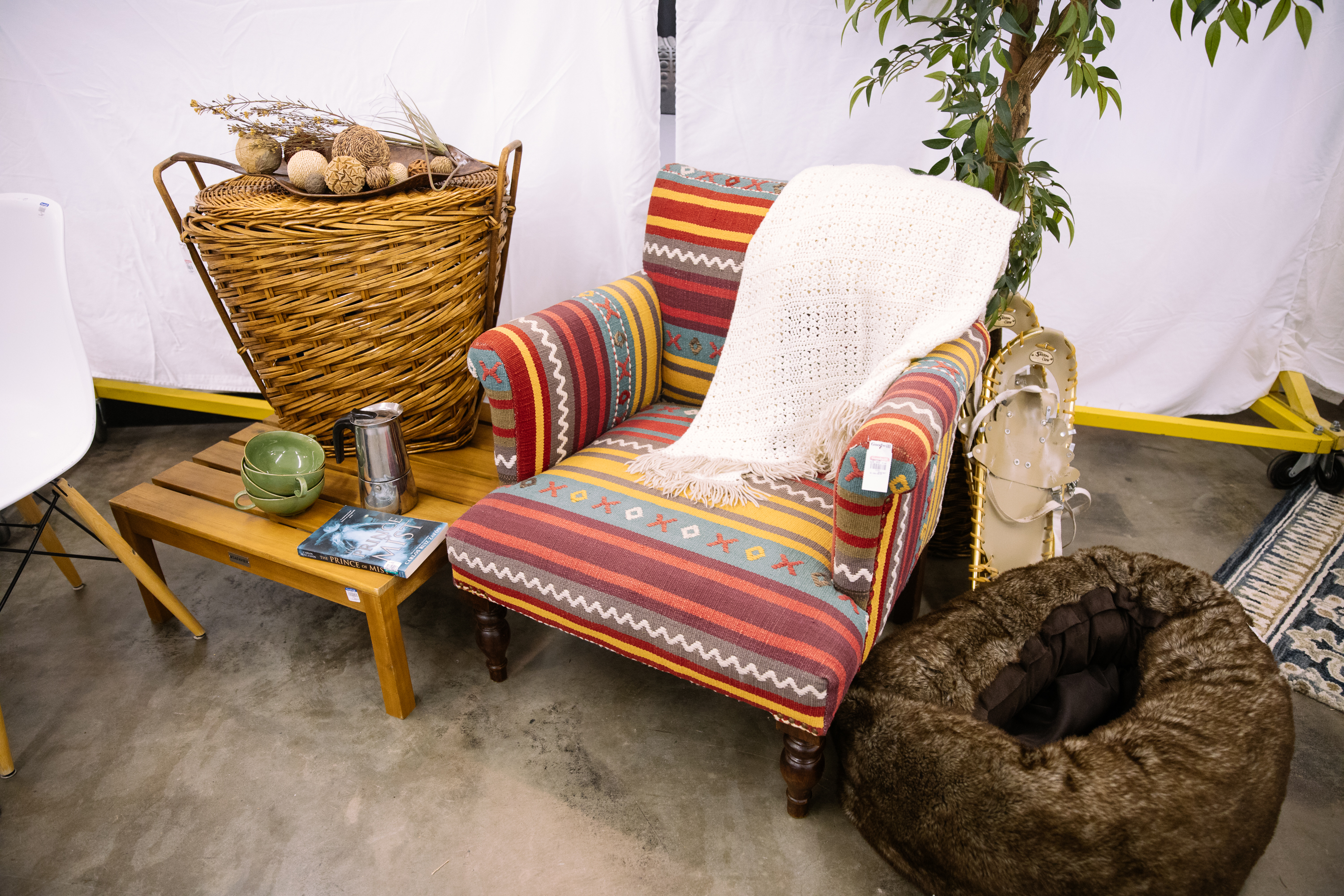 Hygge is a Danish lifestyle that emphasizes being comfy and cozy. Items from Seattle Goodwill including books, blankets, pillows, furniture, mugs and candles can help you create a warm, inviting home on a budget. DIY Guy and Decor Expert Gary Foy showed Refined how to relax and embrace the art of Hygge, including simple projects you can create to make your time at home special. (Photo: Seattle Goodwill)