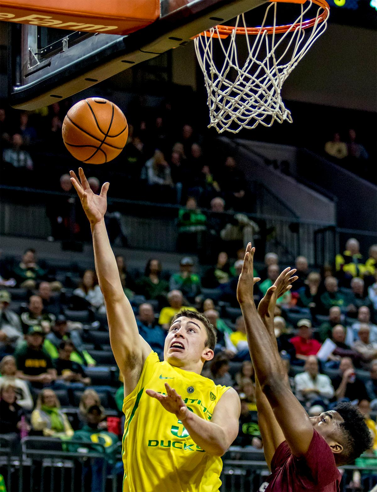 The Duck's Payton Pritchard (#3) tosses the ball up and into the basket. The Oregon Ducks defeated Texas Southern Tigers 74-68. The Ducks are now 7-3 overall in the Pac-12. Photo by August Frank. Oregon News Lab