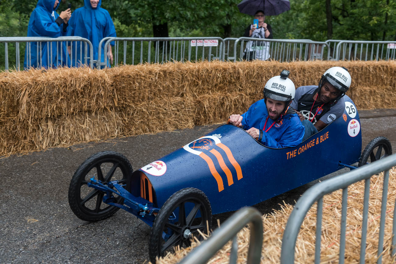 The RedBull Soapbox Race was (kind of) held on Saturday, September 8. Over 50 non-motorized, human-powered racing cars sporting different designs were ready to speed downhill through Eden Park. Unfortunately, due to rainy conditions, only 26 teams were able to compete. RedBull has held 100+ soapbox races around the world over the last 18 years; this year's event was Cincinnati's third soapbox race. / Image: Mike Menke // Published: 9.9.18