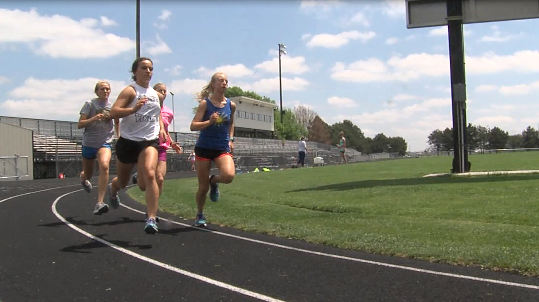 Members of the Grand Island Northwest track team warm up with 200 M sprints on May 16, 2017 (NTV News)