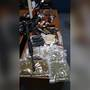 Police: Firearms, drugs and thousands in cash seized in traffic stop