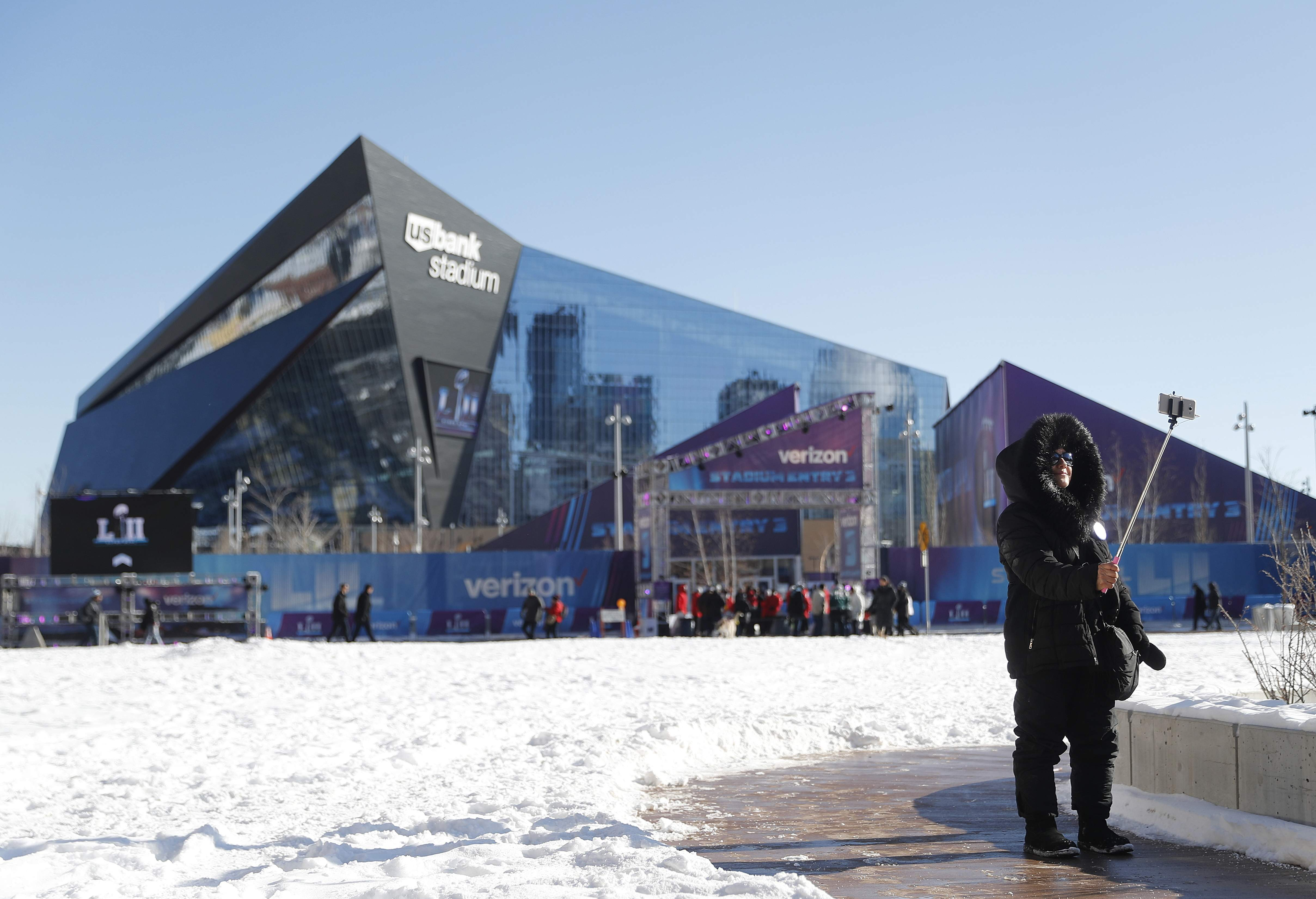 Beno Naeunan takes a selfie outside U.S. Bank Stadium before the NFL Super Bowl 52 football game between the Philadelphia Eagles and the New England Patriots Sunday, Feb. 4, 2018, in Minneapolis. (AP Photo/Jeff Roberson)