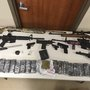 Police seize drugs, stolen guns and arrest four after serving search warrant