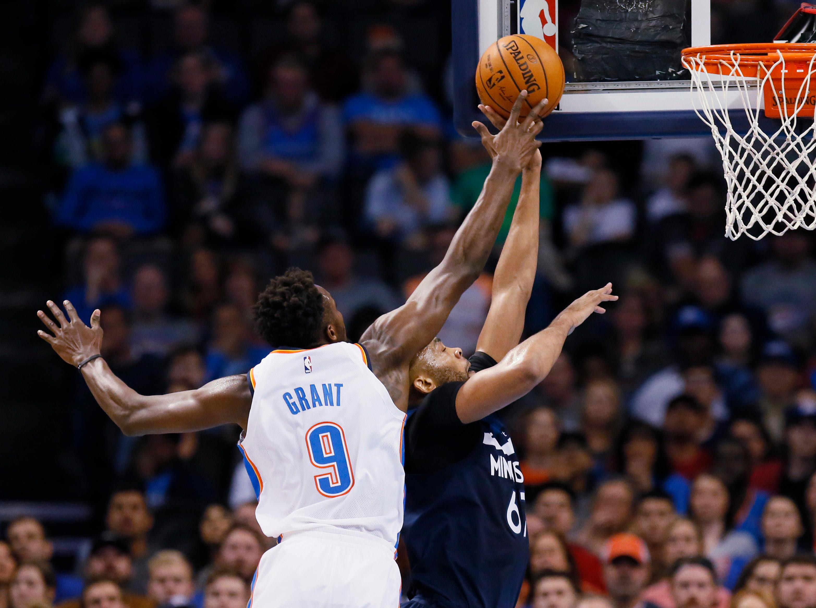 Oklahoma City Thunder forward Jerami Grant (9) gets his hand on the ball as Minnesota Timberwolves forward Taj Gibson (67) shoots during the first quarter of an NBA basketball game in Oklahoma City, Friday, Dec. 1, 2017. (AP Photo/Sue Ogrocki)