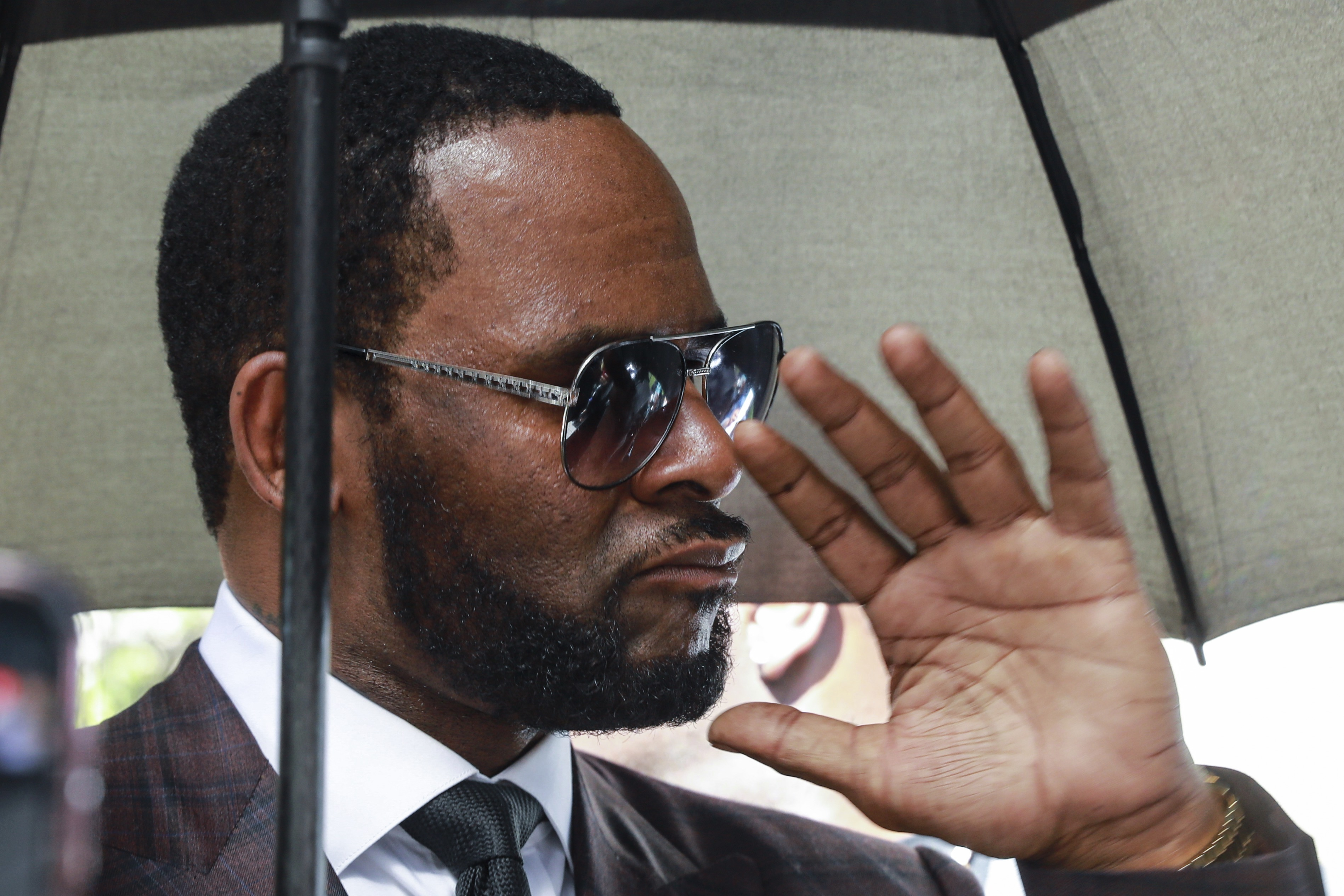 Musician R. Kelly departs from the Leighton Criminal Court building after a status hearing in his criminal sexual abuse trial Wednesday, June 26, 2019 in Chicago. (AP Photo/Amr Alfiky)