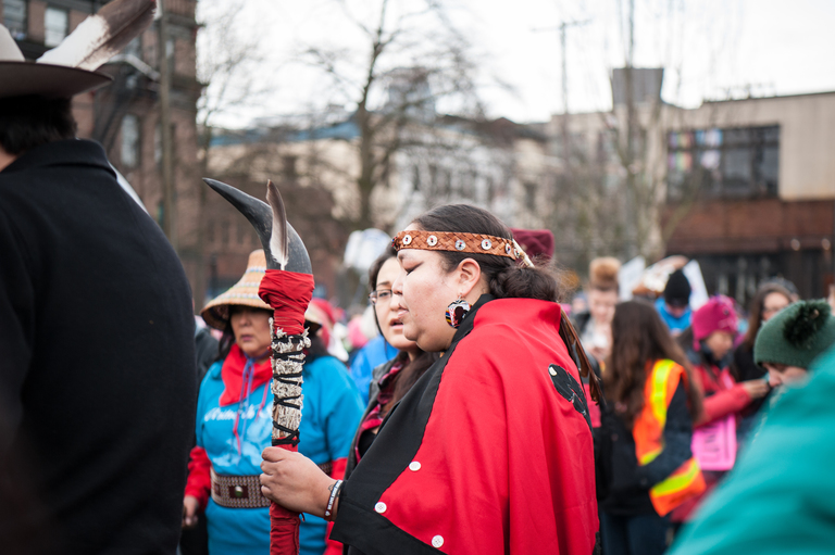 Behind every strong incredible woman, is another strong incredible woman, and another! And another! And a man who supports strong incredible women! So was this case today, January 20  when tens of thousands of marchers headed for Seattle Center on Saturday morning for the Seattle Women's March 2.0. From Capitol Hill, the marchers filled the streets as they passed by downtown buildings. The march then headed to its final destination at Seattle Center. (Image: Elizabeth Crook / Seattle Refined)