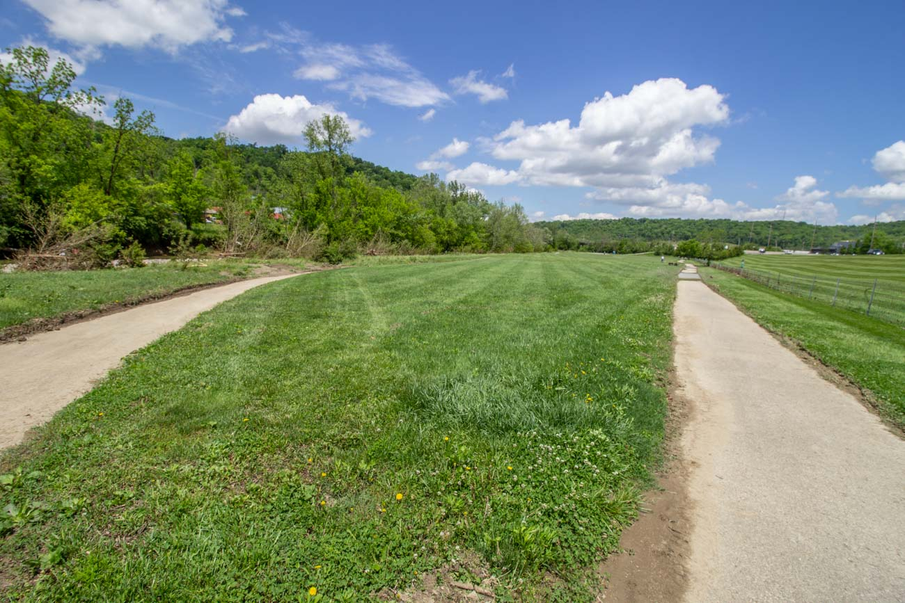 The Red Loop trail is .45 miles long and wraps around a large grassy field that is typically set up with soccer goals. / Image: Katie Robinson, Cincinnati Refined // Published: 6.14.20