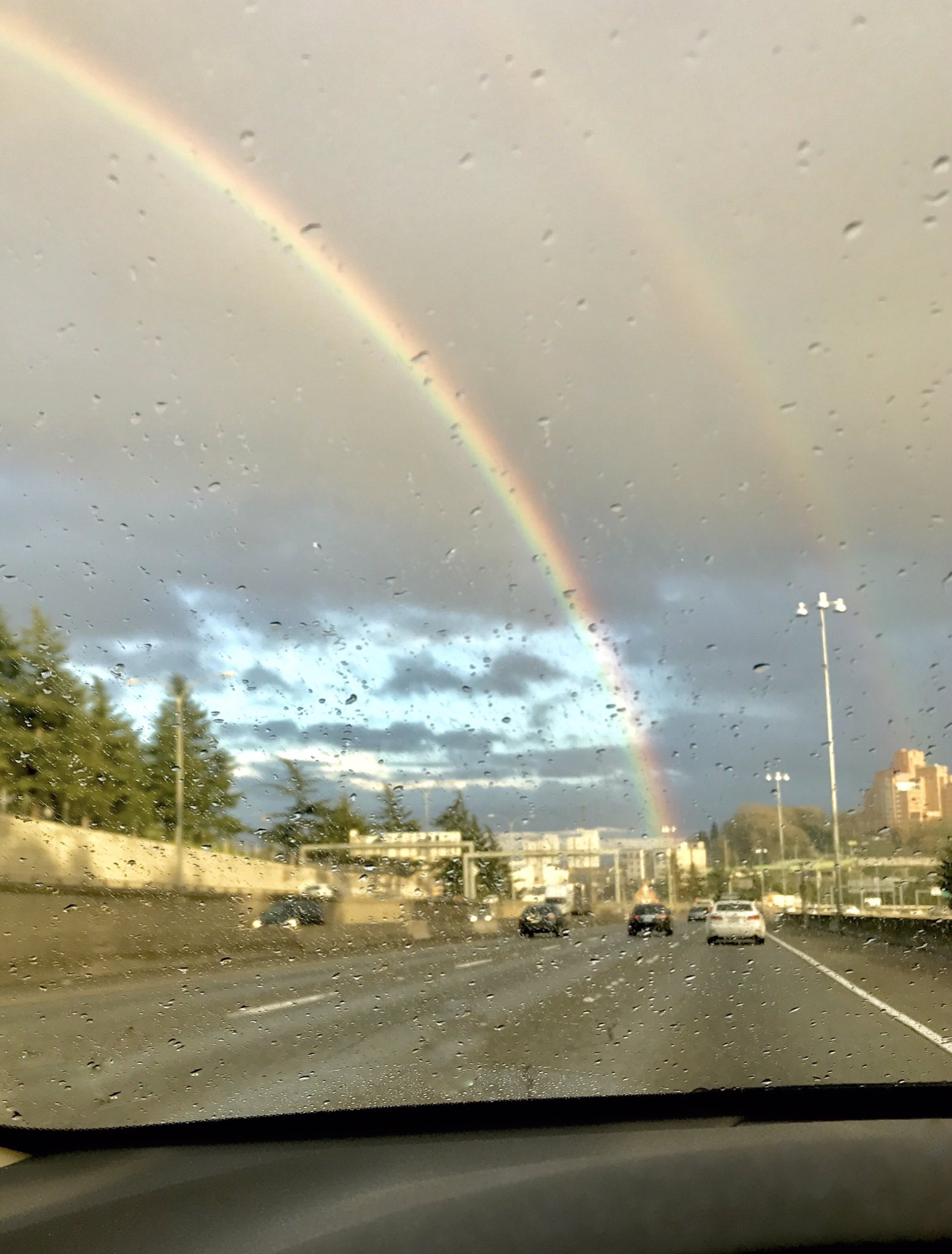Two rainbows are seen over the freeway in Seattle, Monday, April 10, 2017. (Photo: Michele Morin)