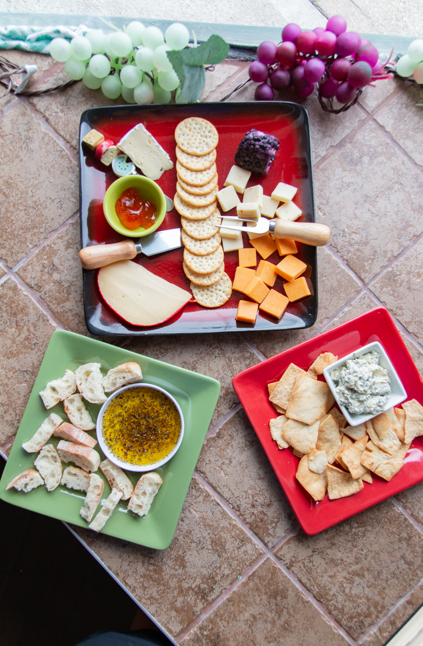 Appetizers including cheese and crackers plate, bread with dipping oil, and spinach dip with pita chips / Image: Elizabeth A. Lowry // Published: 9.30.20