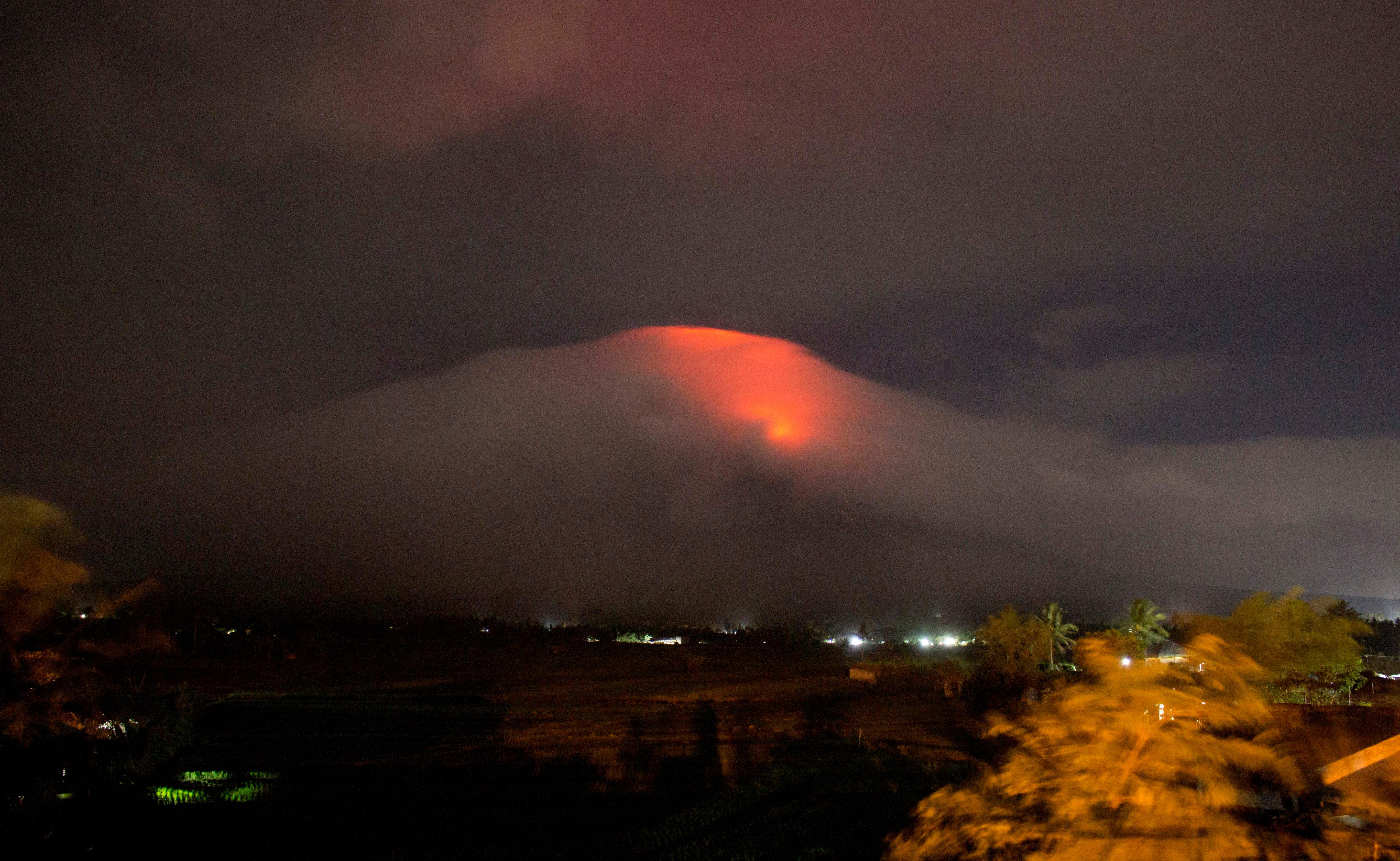 In this Sunday, Jan. 14, 2018, photo provided by Earl Recamunda, an orange glow is seen at the cloud-shrouded crater of Mayon volcano at Legazpi city, Albay province, about 340 kilometers (210 miles) southeast of Manila, Philippines. (Earl Recamunda via AP)<p></p>