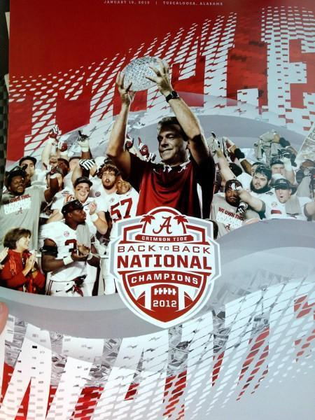 """Title Wave"" posters handed out to Alabama fans for the BCS Champions parade in Tuscaloosa on Saturday, January 19, 2012."
