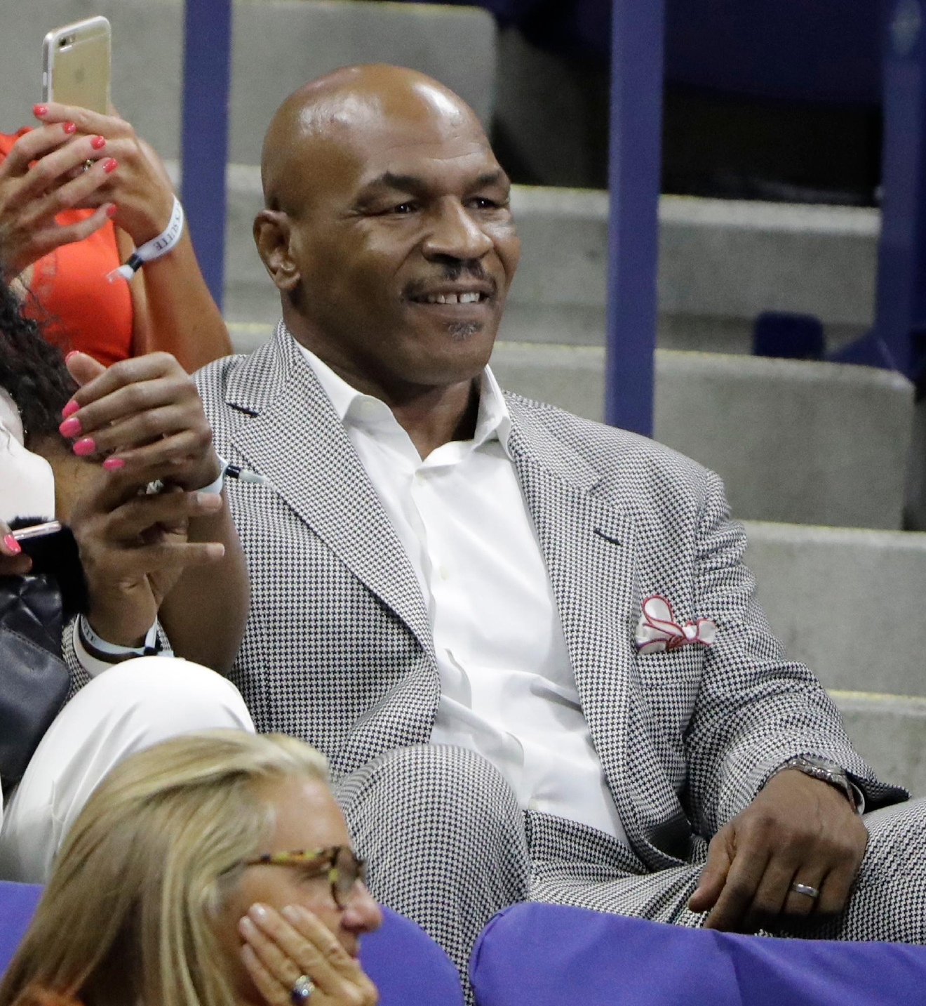 Former heavyweight boxing champion Mike Tyson watches the Novak Djokovic, of Serbia, and Jerzy Janowicz, of Poland, first round match during the US Open tennis tournament, Monday, Aug. 29, 2016, in New York. (AP Photo/Darron Cummings)
