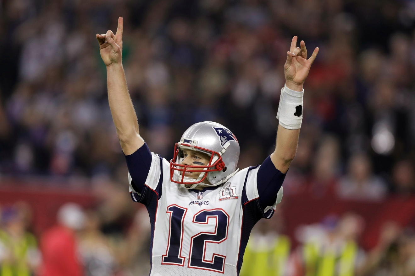 New England Patriots' Tom Brady raises his arms after scoring a touchdown during overtime of the NFL Super Bowl 51 football game against the Atlanta Falcons, Sunday, Feb. 5, 2017, in Houston. The Patriots defeated the Falcons 34-28. (AP Photo/Darron Cummings)