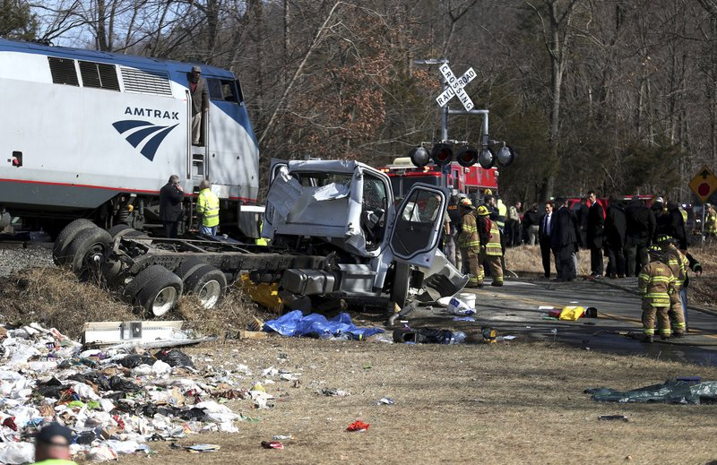 <p>Emergency personnel work at the scene of a train crash involving a garbage truck in Crozet, Va., on Wednesday, Jan. 31, 2018. An Amtrak passenger train carrying dozens of GOP lawmakers to a Republican retreat in West Virginia struck a garbage truck south of Charlottesville, Va. No lawmakers were believed injured. (Zack Wajsgrasu/The Daily Progress via AP)</p>