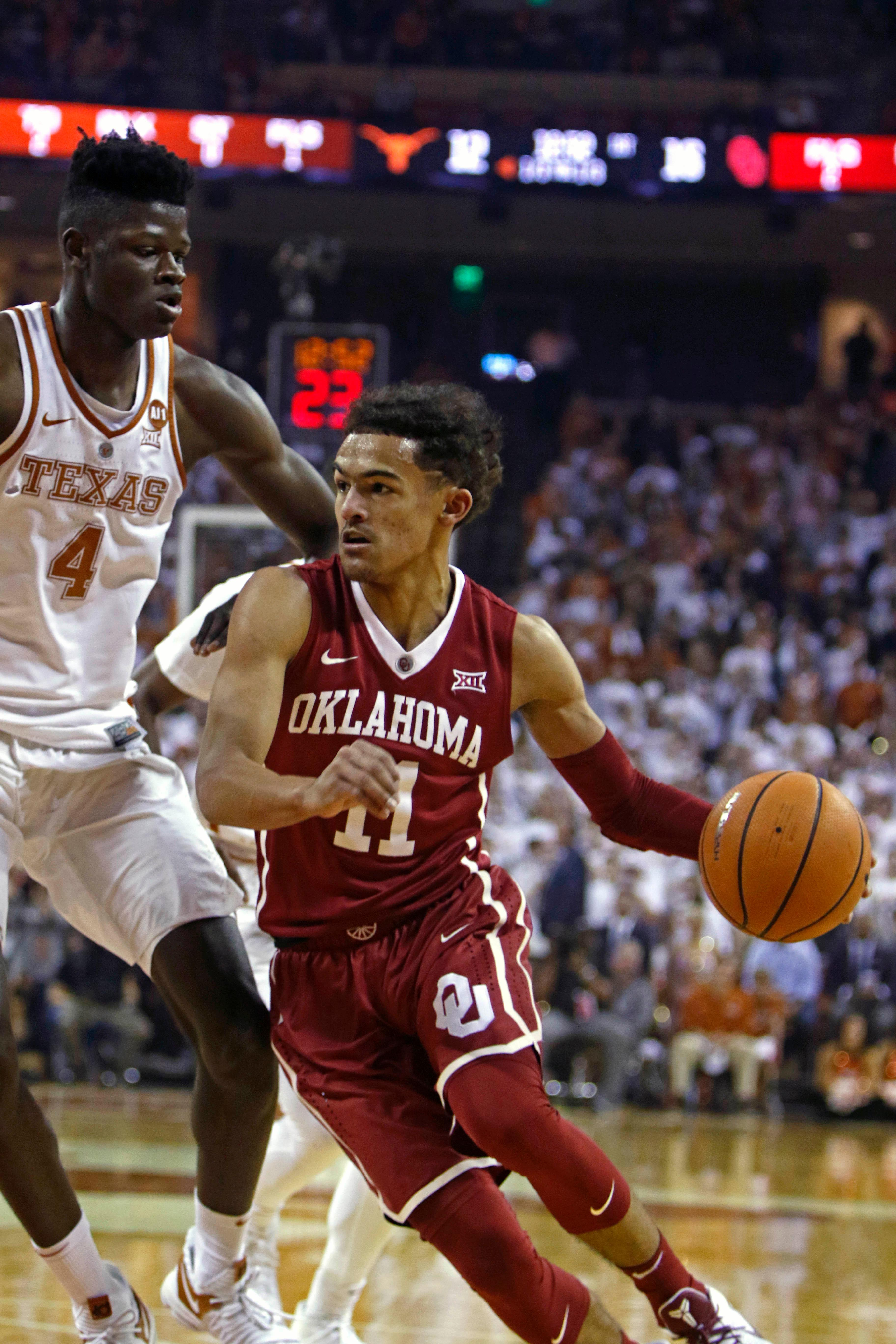 Oklahoma guard Trae Young (11) drives the ball against Texas center Mohamed Bamba (4) during the first half of an NCAA college basketball game, Saturday, Feb. 3, 2018, in Austin, Texas. (AP Photo/Michael Thomas)