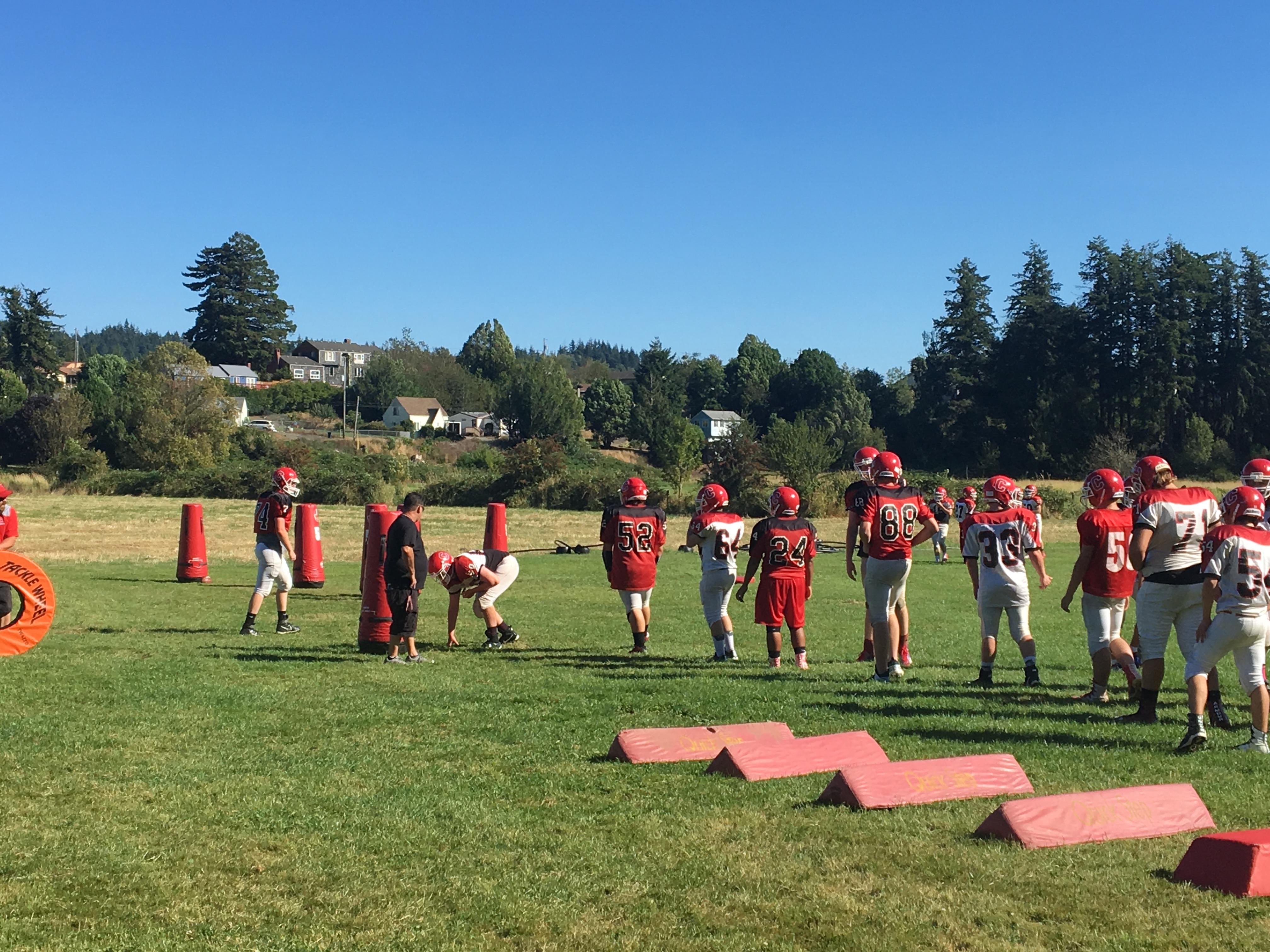 The Coquille football team practices before their season-opening game, August 30, 2017. (SBG)