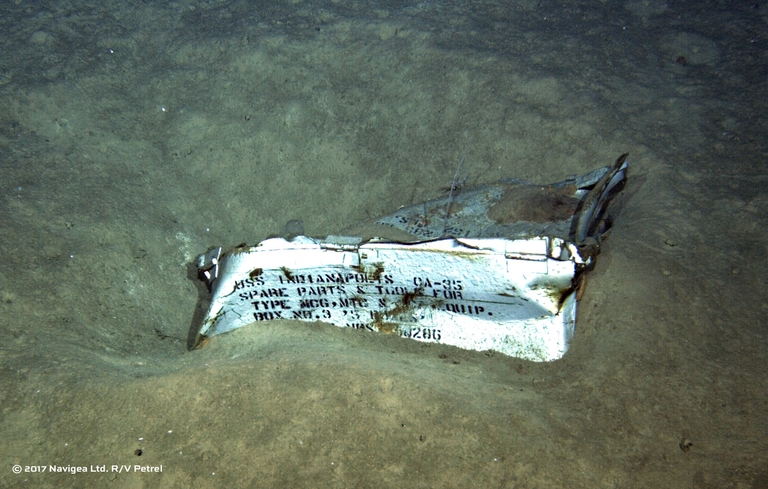 An image shot from a remotely operated underwater vehicle shows a spare parts box from USS Indianapolis on the floor of the Pacific Ocean in more than 16,000 feet of water. Photo courtesy Paul G. Allen.
