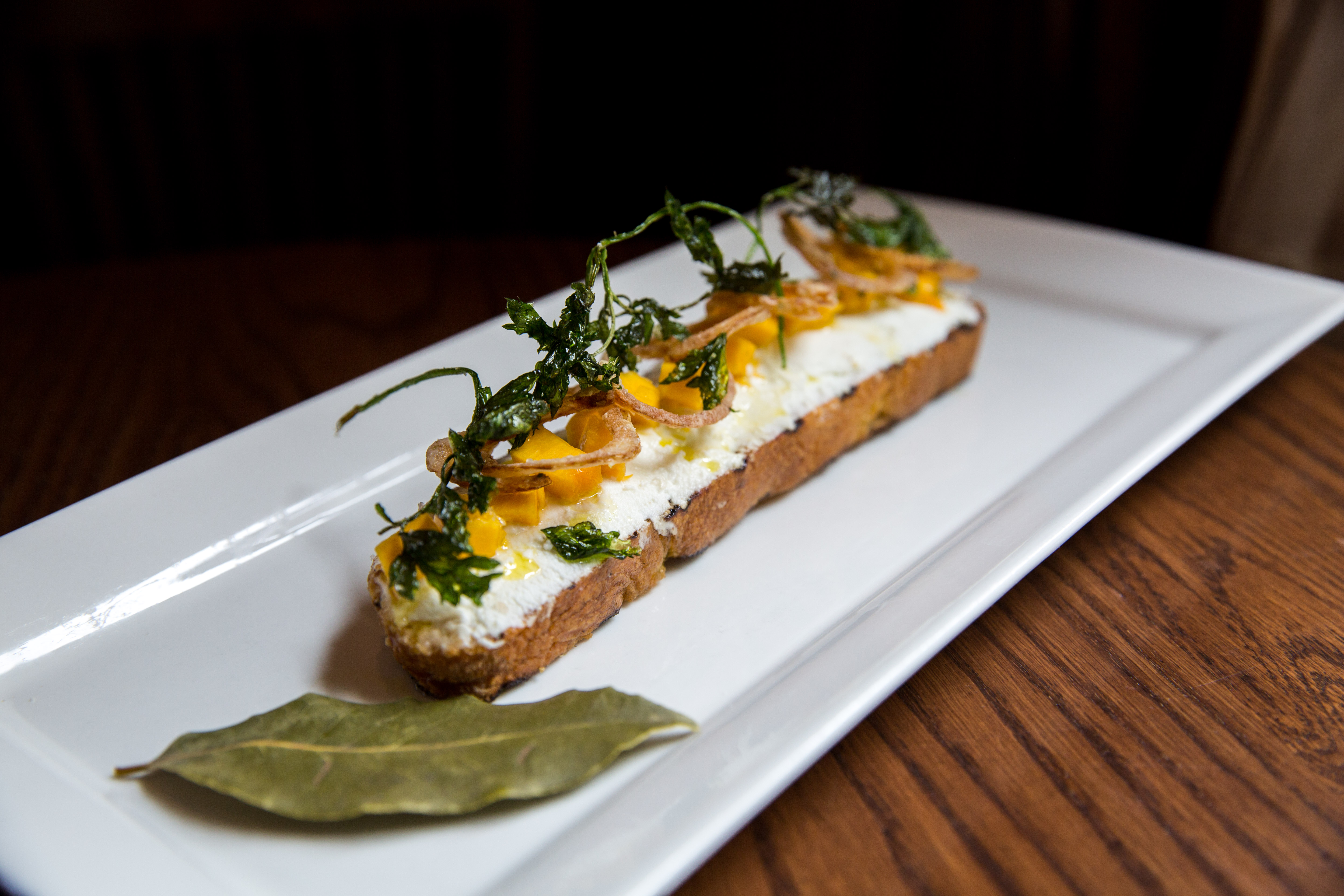 Pumpkin Bruschetta, grilled ciabatta goat cheese, sweet & sour pumpkin fried shallots, parsley.{ } You can find these amazing pumpkin items at Tulio until October 31! (Image: Adela Lee).