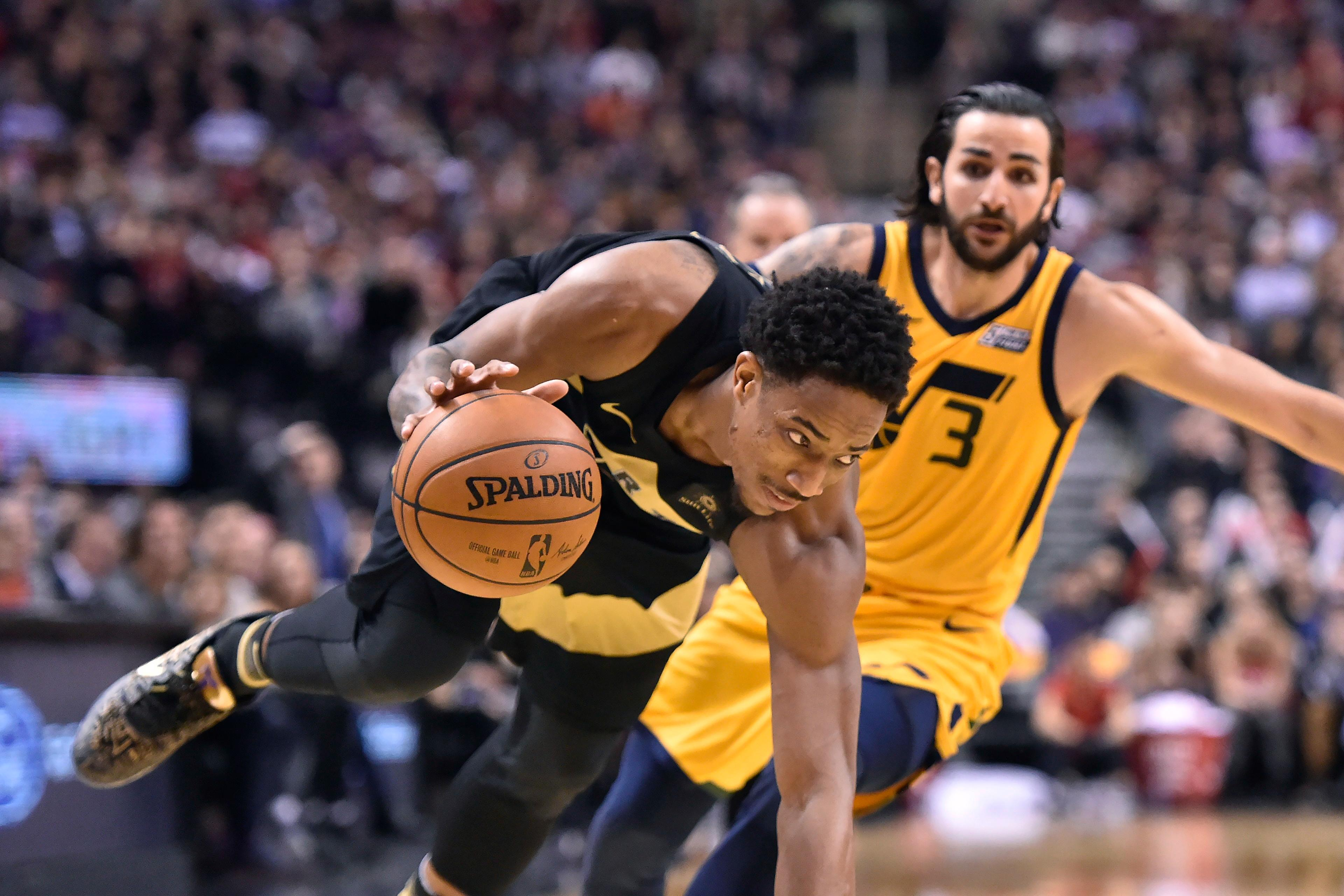 Toronto Raptors guard DeMar DeRozan drives around Utah Jazz guard Ricky Rubio (3) during the second half of an NBA basketball game Friday, Jan. 26, 2018, in Toronto. (Frank Gunn/The Canadian Press via AP)