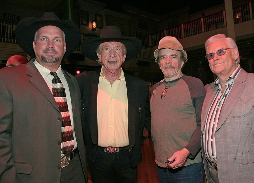 Merle Haggard, third from left, is seen with Garth Brooks, Buck Owens and George Jones in a photo provided Wednesday, April 6, 2016, by Buck Owens Production Co. Music legend Haggard died Wednesday at the age of 79.