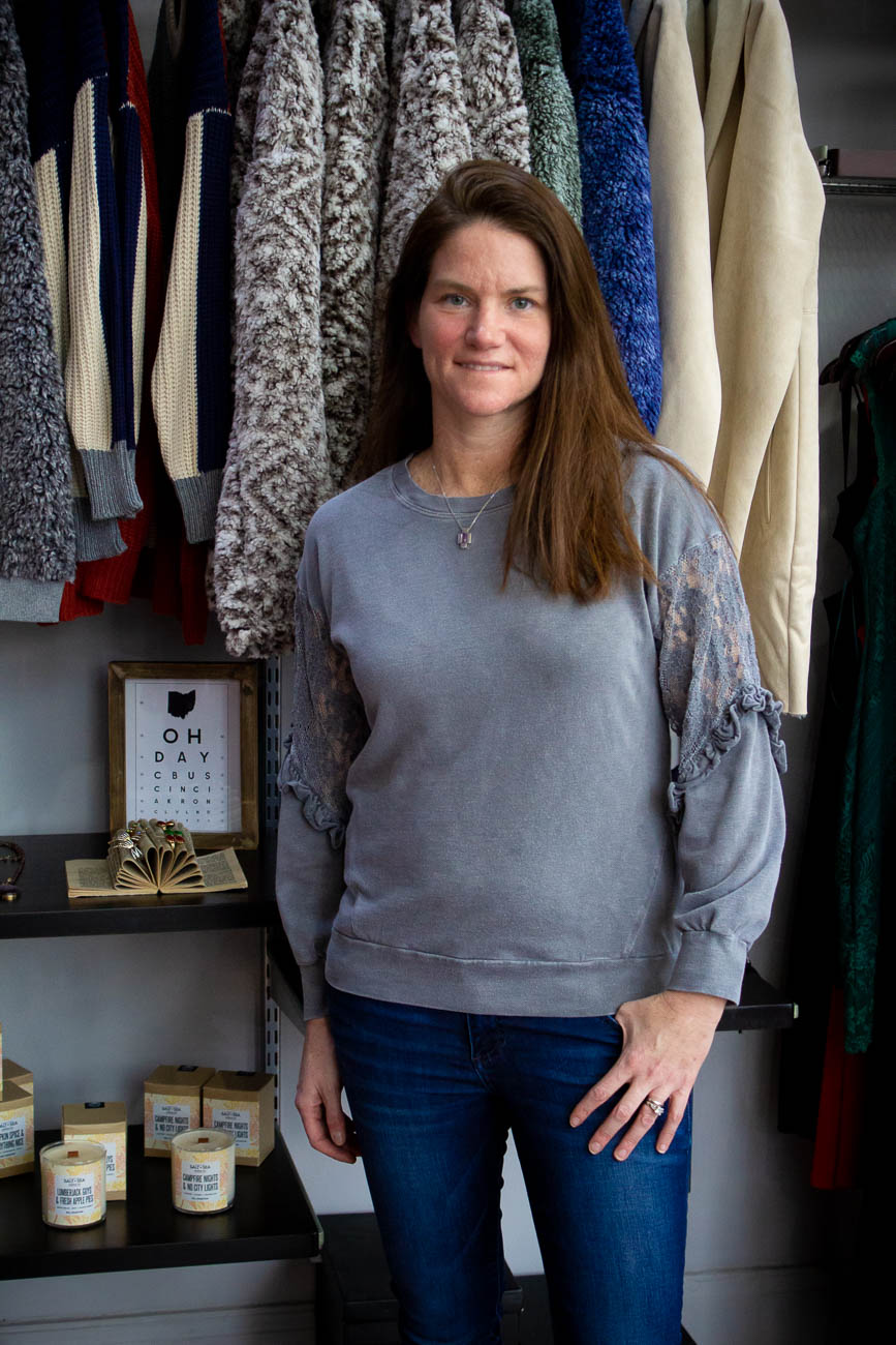 "Florence, KY native Stephanie Rozanovich returned home after working a corporate job for 12 years in Boston with the dream of opening her own Cincinnati boutique to provide affordable, unique finds to people wanting to stand out around town. Her favorite part of the business is the ""full circle"" rewarding aspect of selecting a fashion piece, selling it, and then having customers return to express their love for it. Keeping with the spirit of ""full circle,"" she also manages to keep her clothing finds rotating to introduce new pieces as frequently as possible. ADDRESS: 2946 Markbreit Avenue (45209) / Image: Katie Robinson, Cincinnati Refined // Published: 1.10.19"