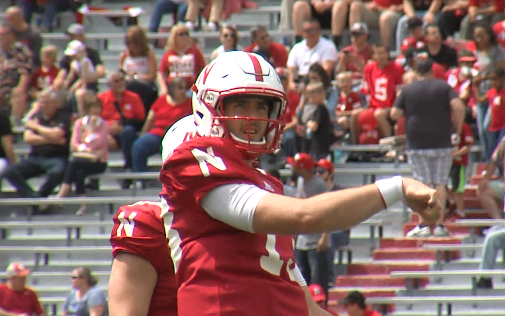 Tanner Lee follows through a warm-up pass prior to the Huskers Red-White spring game at Memorial Stadium on April 15, 2017 (NTV News)
