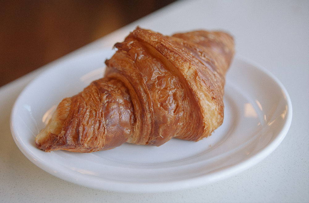 Bakery Nouveau. This croissant has an amazing amber color and an incredibly crunchy outside. (Image: Jenny Kuglin / Seattle Refined)