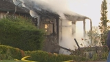 Firefighters douse house fire near Clackamas HS