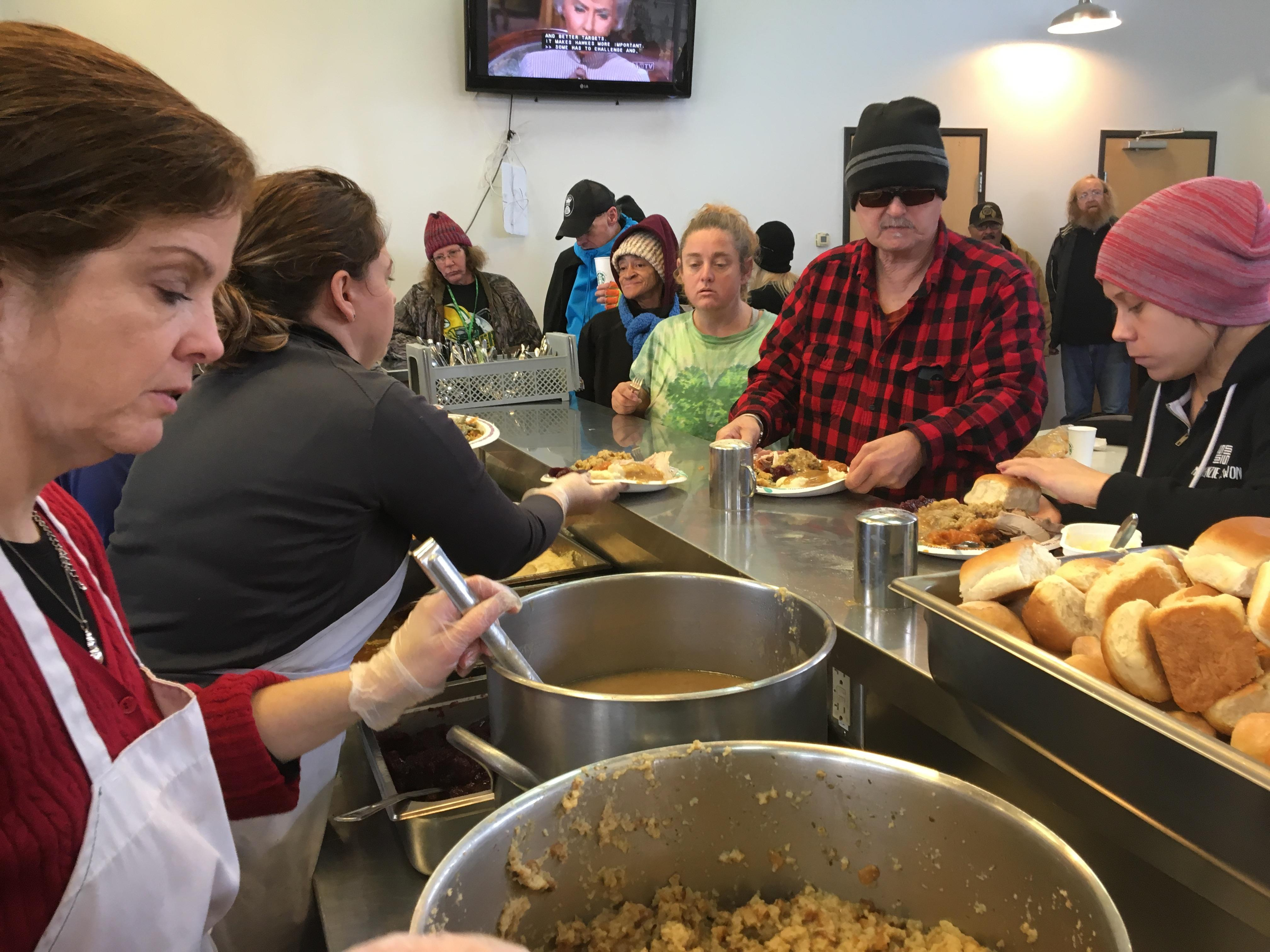 Eugene Police Department staff served a special holiday meal to 200 people at the St. Vincent de Paul Lindholm Center on Highway 99 on Friday. The food was donated by Bruns Apple, and New Day Bakery cooked the meals. The center offers daytime services to adults who are homeless. (SBG)