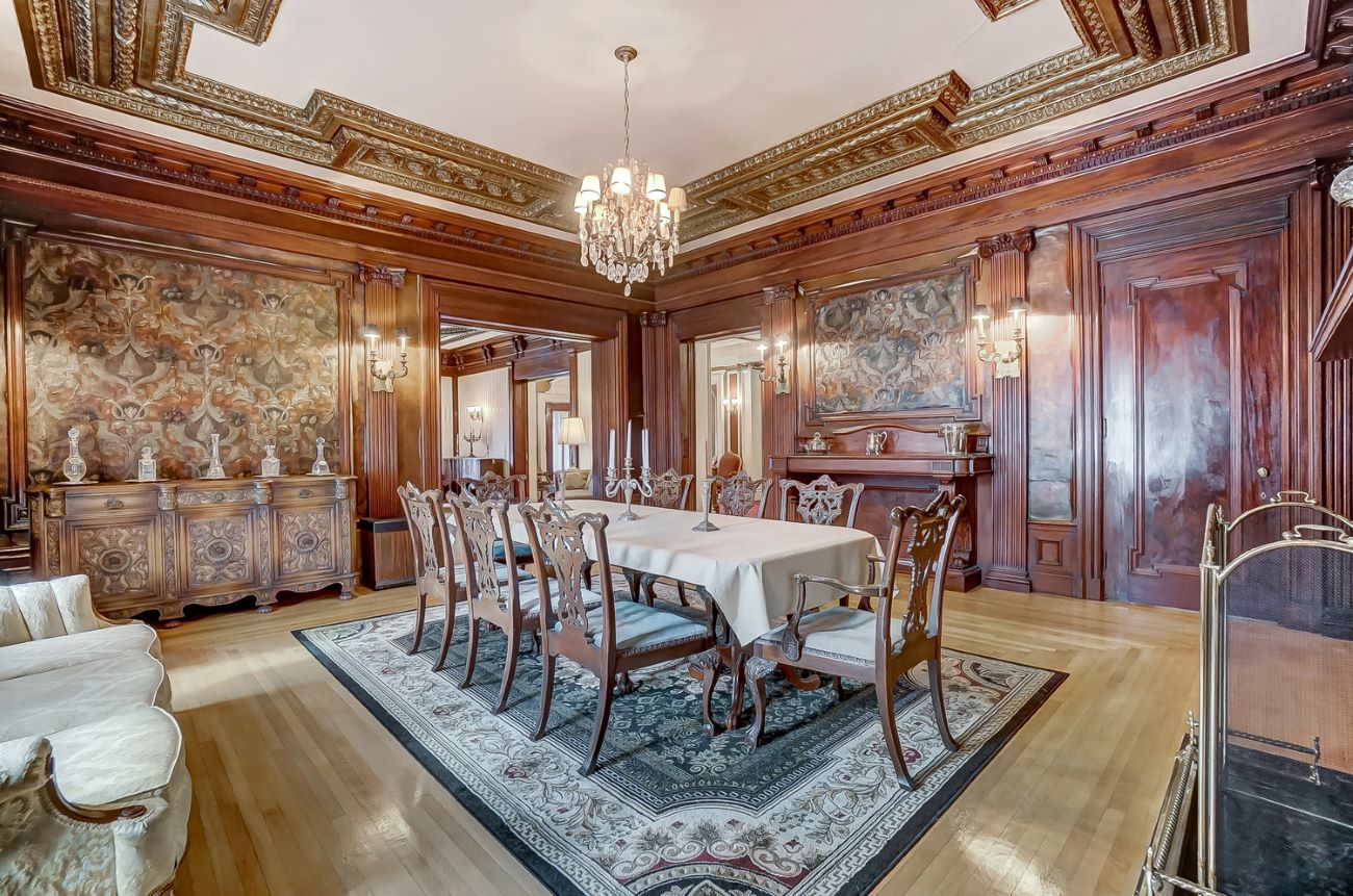 The 20x19-foot formal dining room is a stunner with a fireplace, ornate details, and plenty of room for hosting dinner parties. / Image: Adam Sanregret courtesy of Coldwell Banker West Shell // Published: 4.3.20