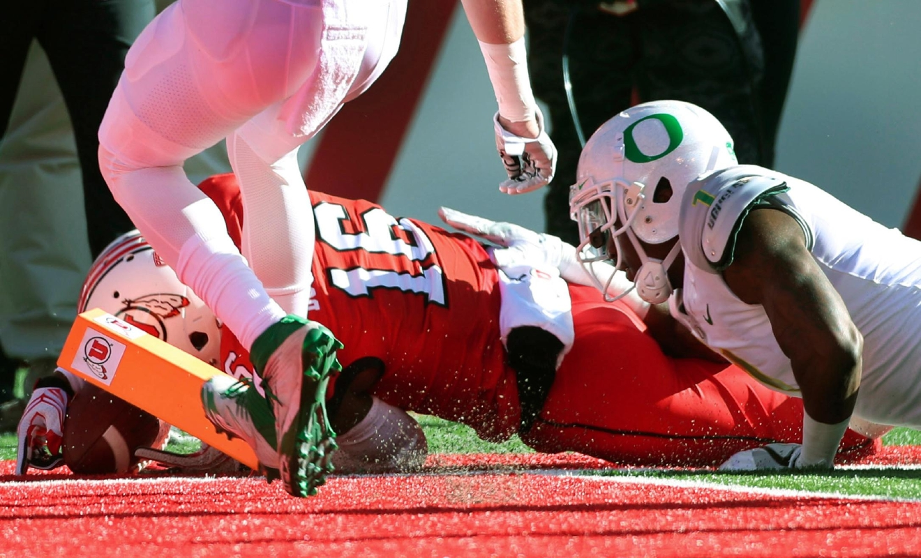 Utah wide receiver Cory Butler-Byrd (16), dives for a touchdown as Oregon defensive back Arrion Springs (1) tries to tackle him in the first half during an NCAA college football game, Saturday, Nov. 19, 2016, in Salt Lake City. (AP Photo/George Frey)