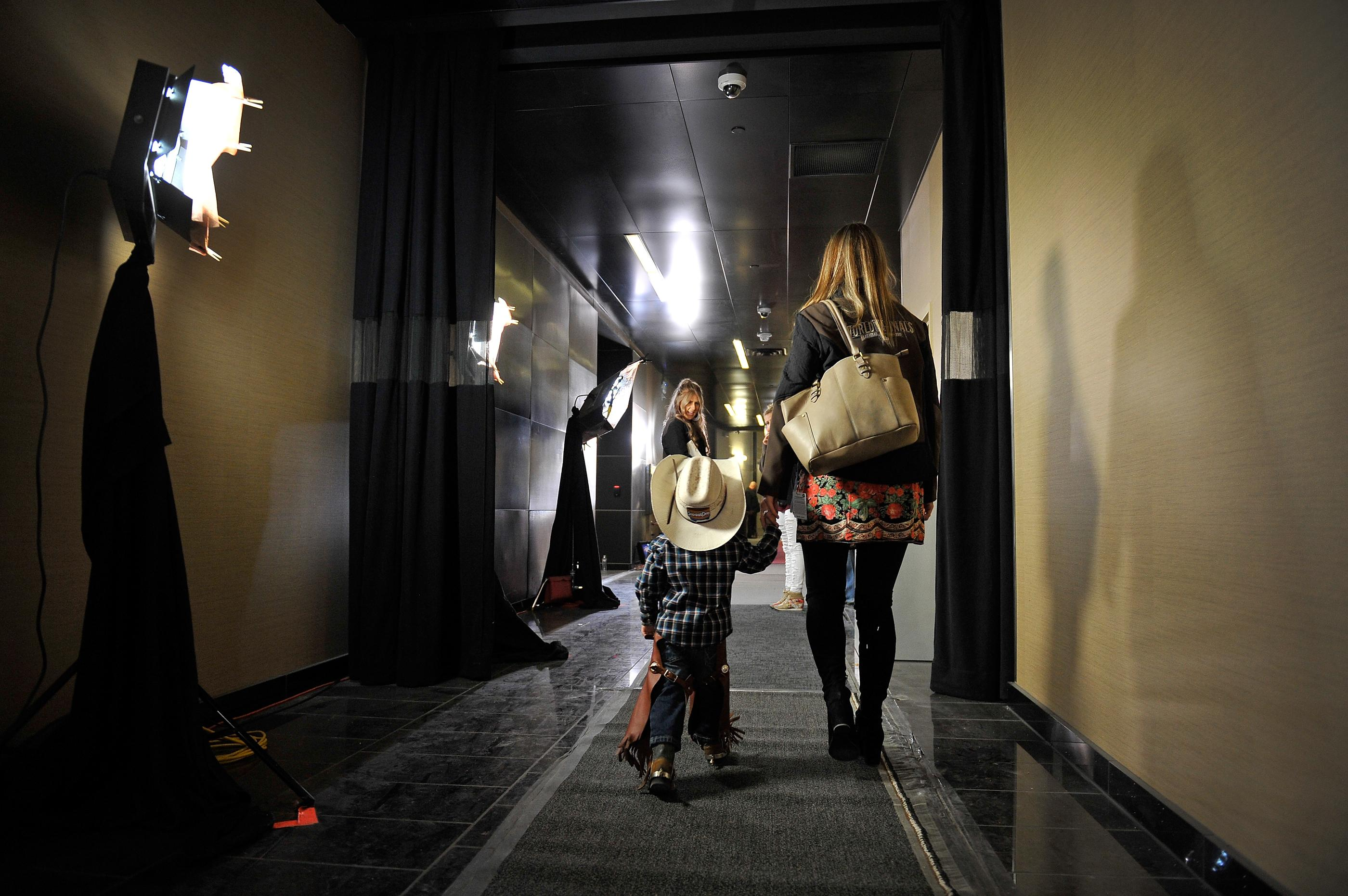 A young cowboy is escorted through the halls during the PBR World Finals at T-Mobile Arena Sunday, Nov. 5, 2017, in Las Vegas. [David Becker/Las Vegas News Bureau]