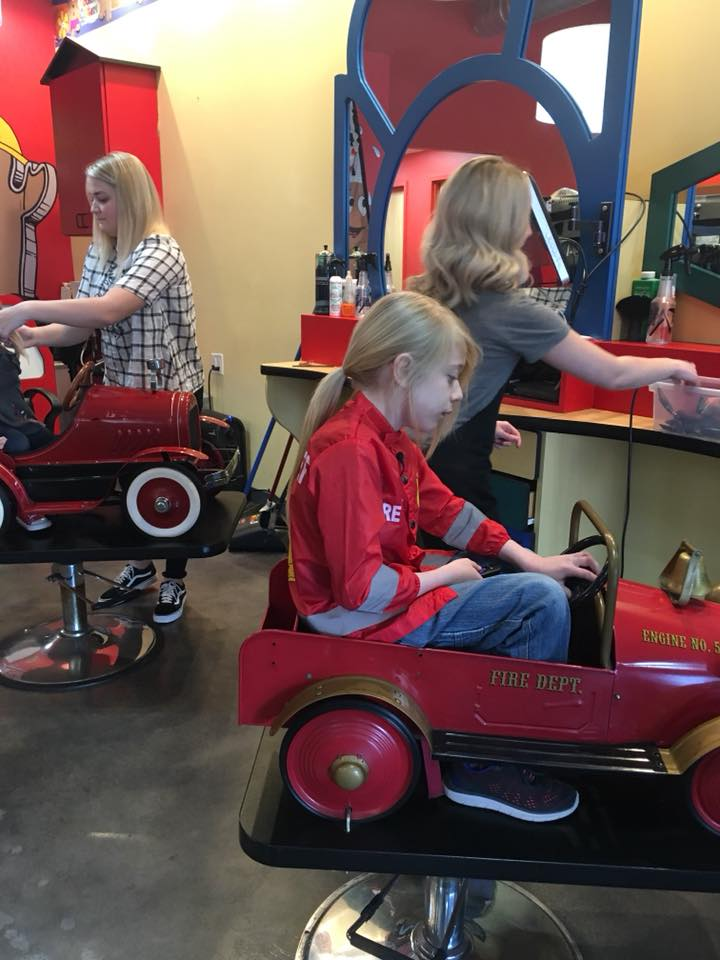 8-year-old Tate Morgan gets his first haircut in more than two years. (Photo: Kassandra Morgan)