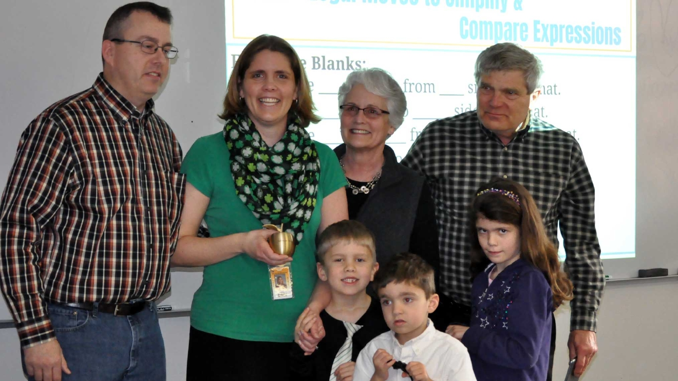 Adrianne Burns celebrates her Golden Apple Award with her family March 8, 2017, at De Pere Middle School. (WLUK/Donna Fischer)