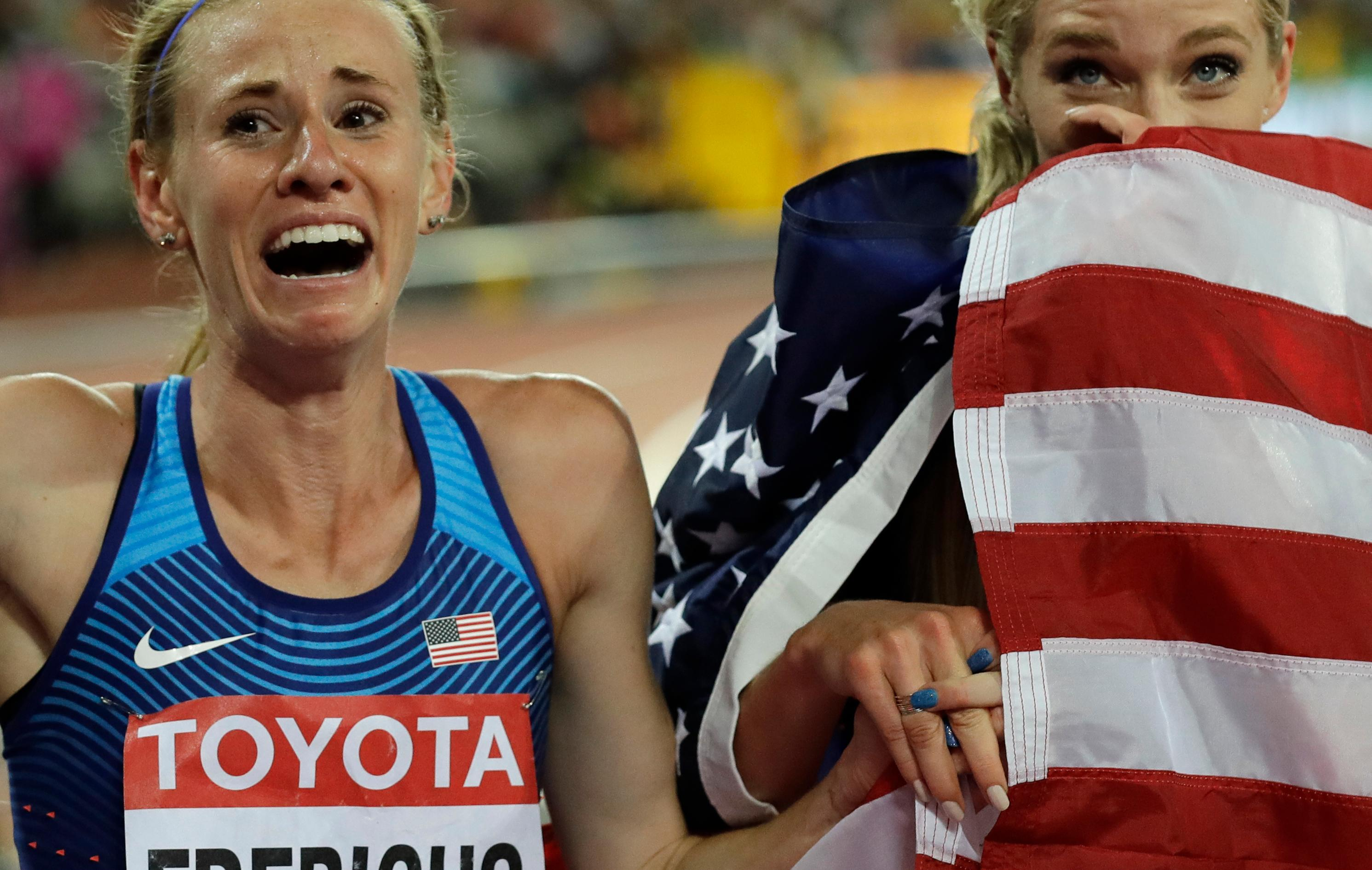 United States' Emma Coburn, right, celebrates with second placed United States' Courtney Frerichs, left, after winning the Women's 3000 meter steeplechase final during the World Athletics Championships in London Friday, Aug. 11, 2017. (AP Photo/Tim Ireland)