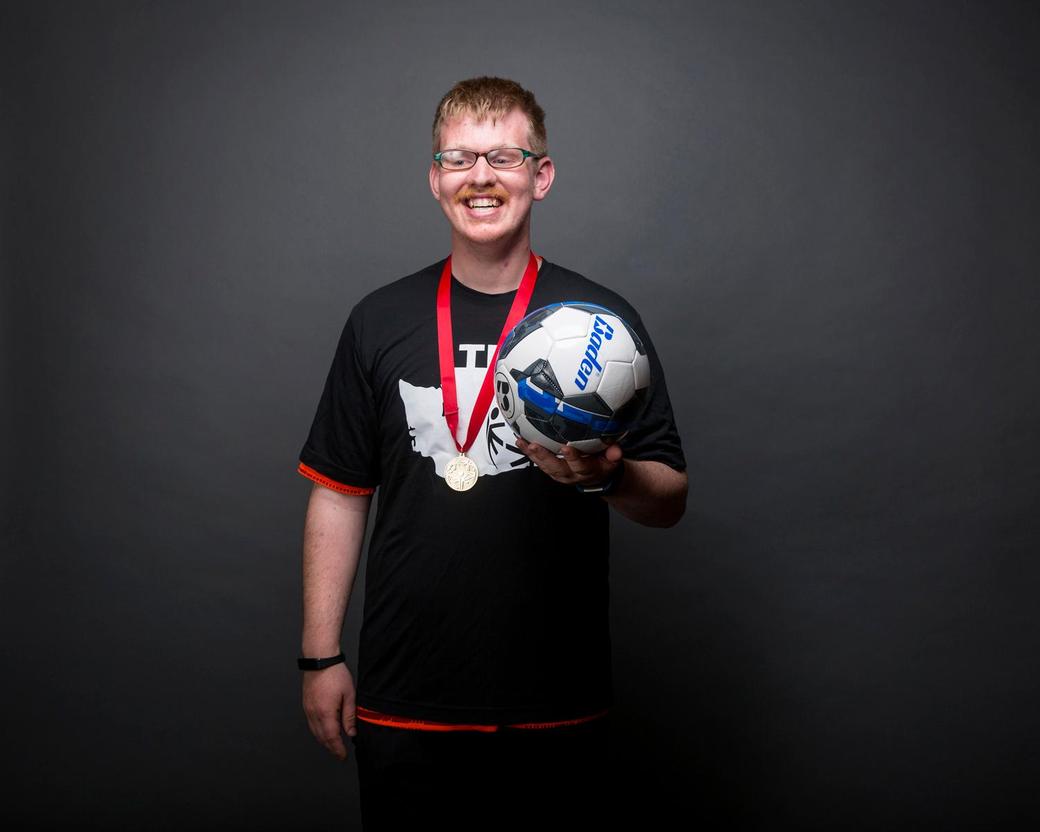 Introducing Joshua Lembke! Joshua will be competing in unified soccer. The Special Olympics USA will take place in Seattle from July 1-6, with a grand opening ceremony and Parade of Athletes and the lighting of the Special Olympics Flame of Hope. (Sy Bean / Seattle Refined)