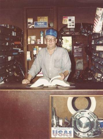 A family photograph shows owner Ray Lambrecht standing behind the service counter at his Chevrolet dealership in Pierce. Ray opened the downtown dealership with his uncle in 1946.