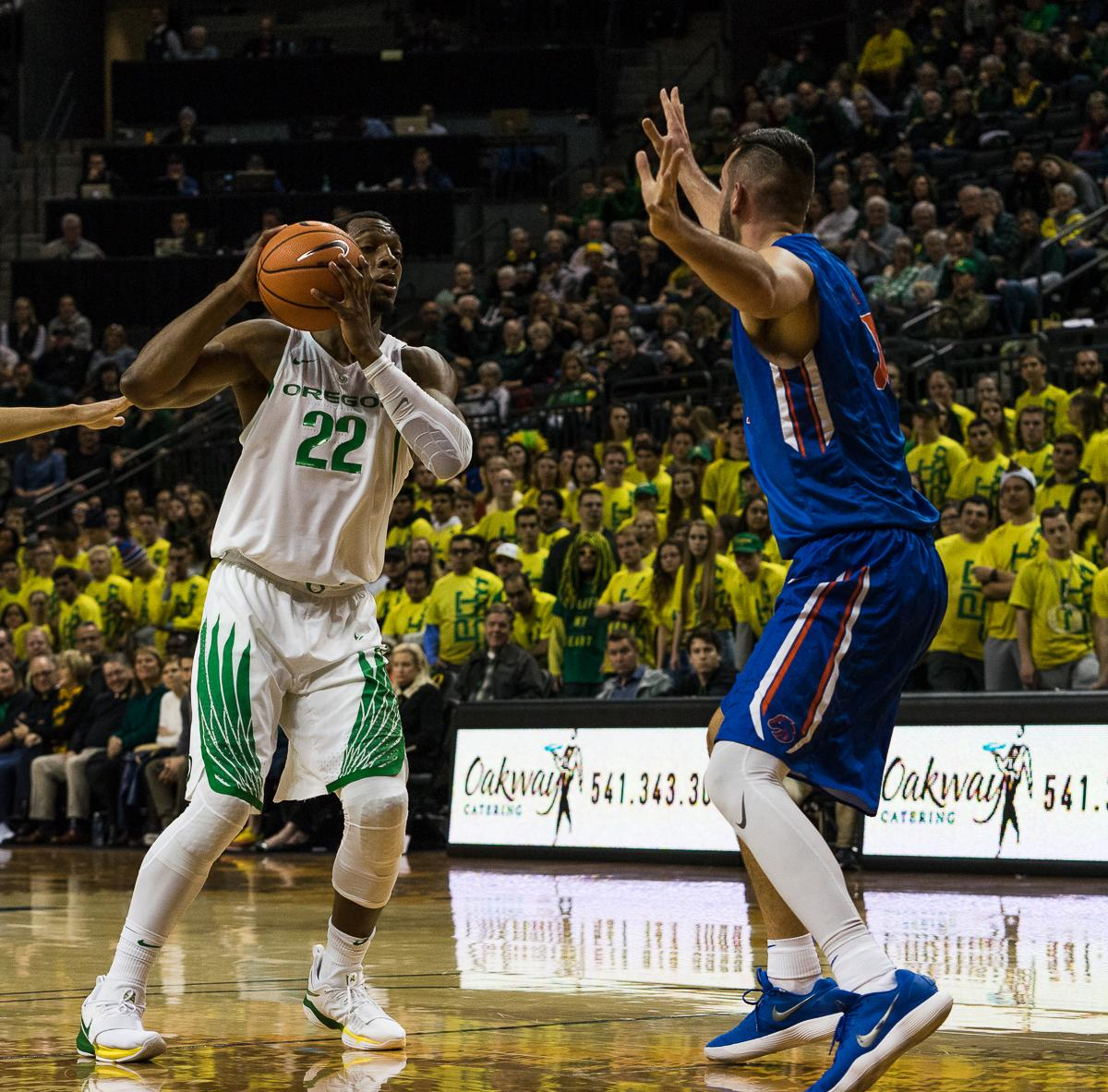 University of Oregon Duck MiKyle McIntosh (#22) is challenged by Boise State's Zach Haney (#11). The Boise State Broncos defeated the University of Oregon Ducks 73 – 70 at Matthew Knight Arena in Eugene, Ore., on December 1, 2017. Photo by Kit MacAvoy, Oregon News Lab