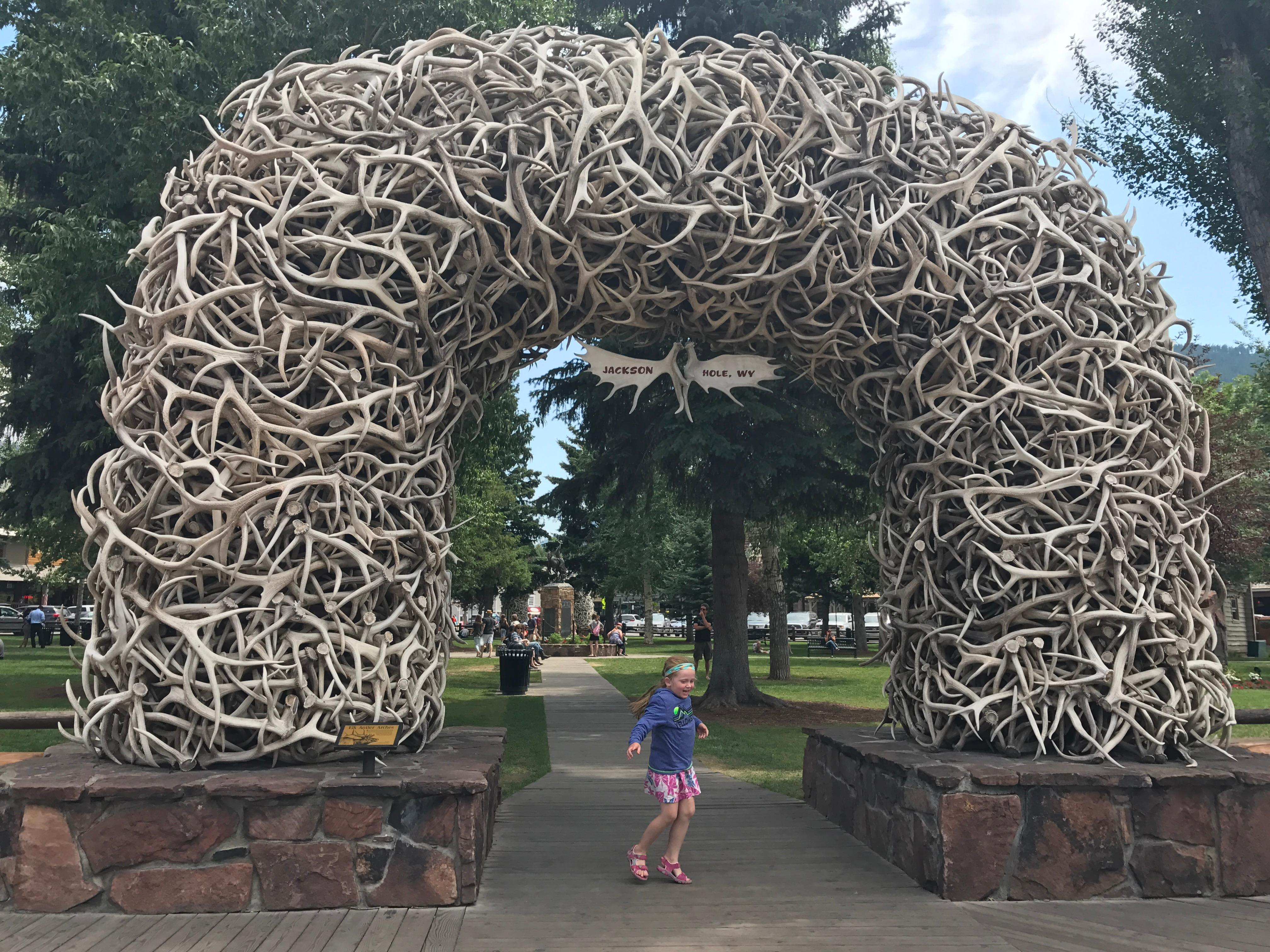 The entrances to Jackson Hole's Town Square are hundreds of antlers. (Image: Rebecca Mongrain/Seattle Refined)
